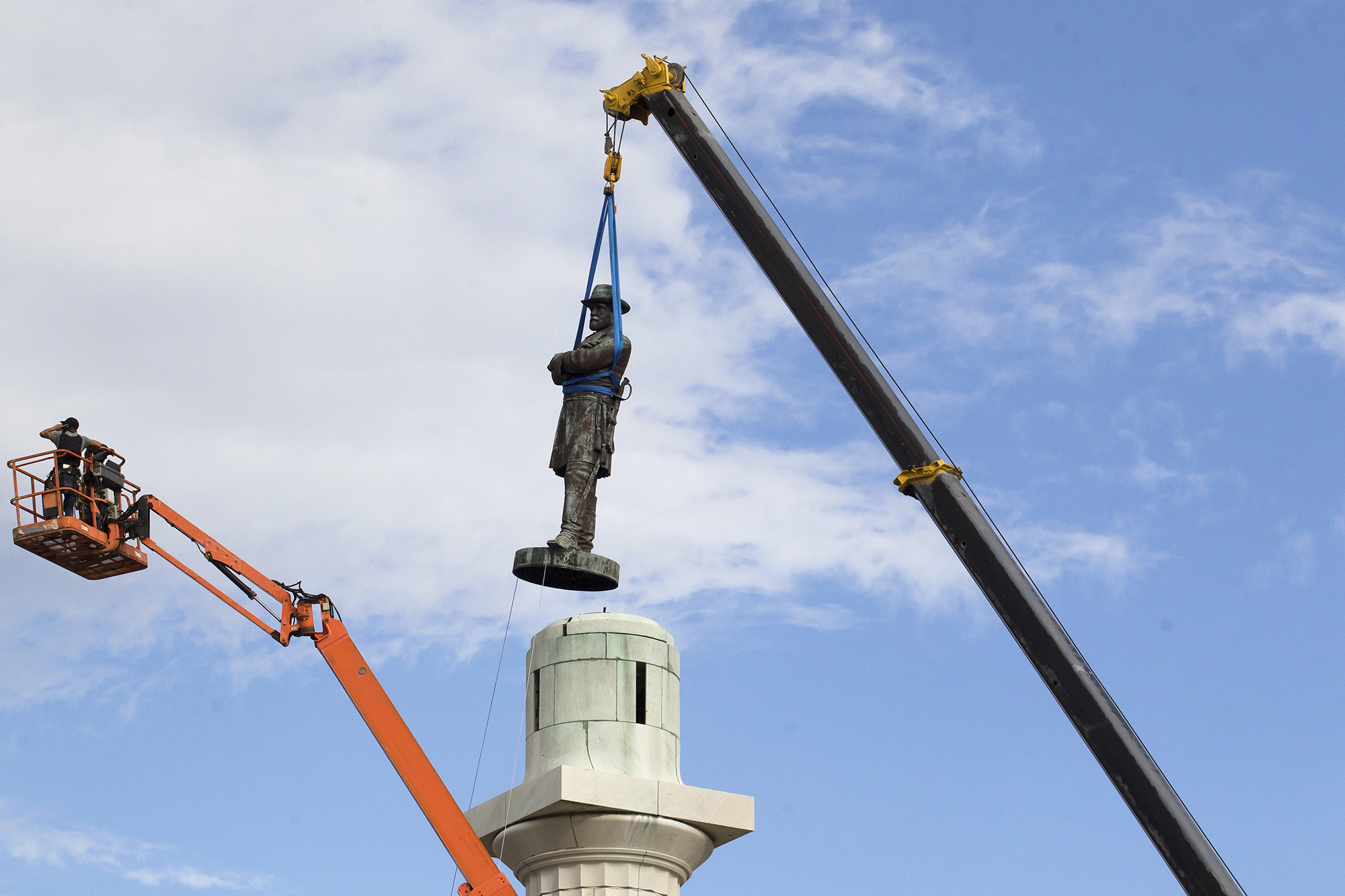 A statue of Confederate General Robert E. Lee is removed from Lee Circle Friday, on May 19, 2017, in New Orleans.