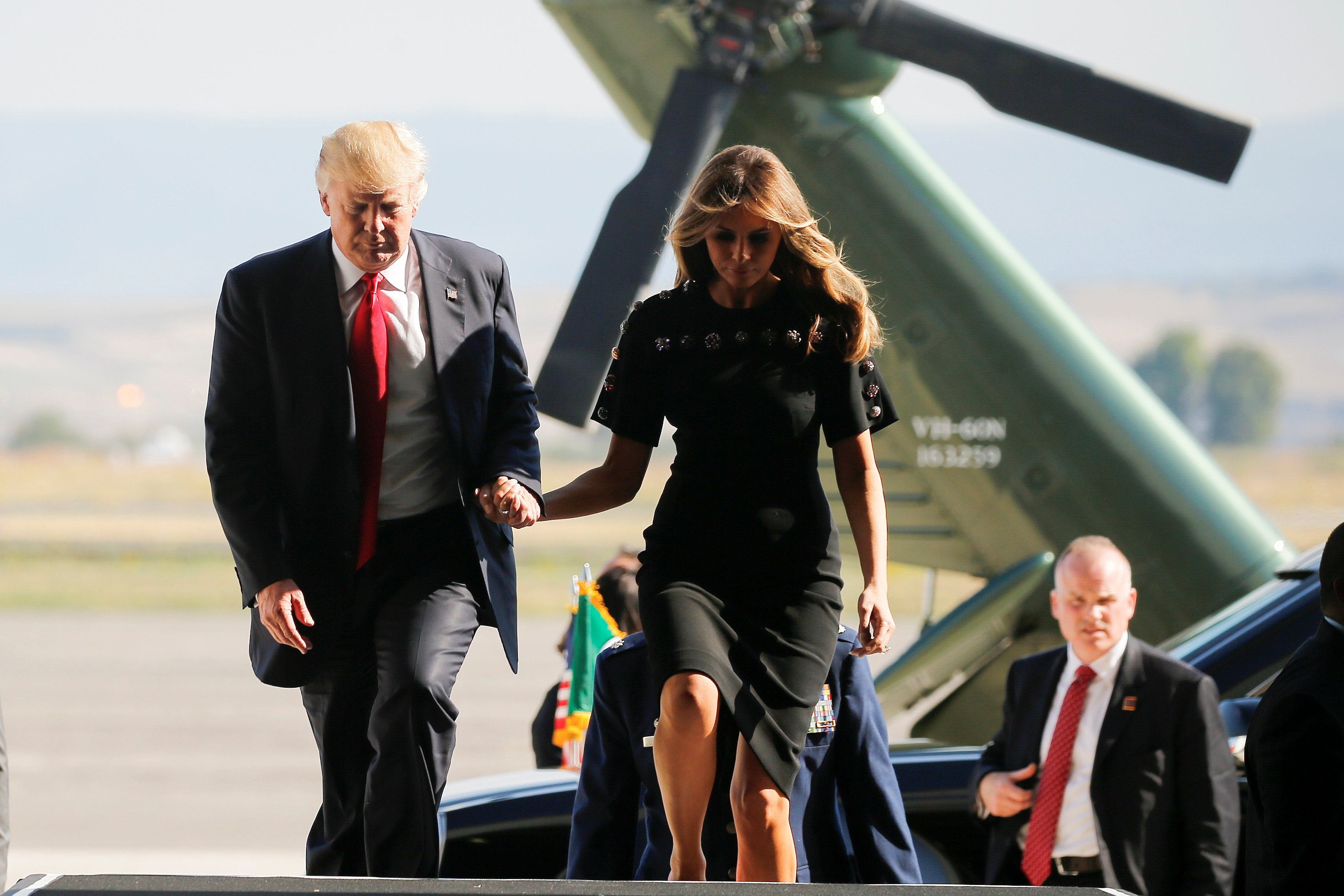 President Trump and first lady Melania Trump hold hands as they arrive at the Naval Air Station Sigonella to visit U.S. troops before returning to Washington D.C. at Sigonella Air Force Base in Sicily, Italy, May 27, 2017.