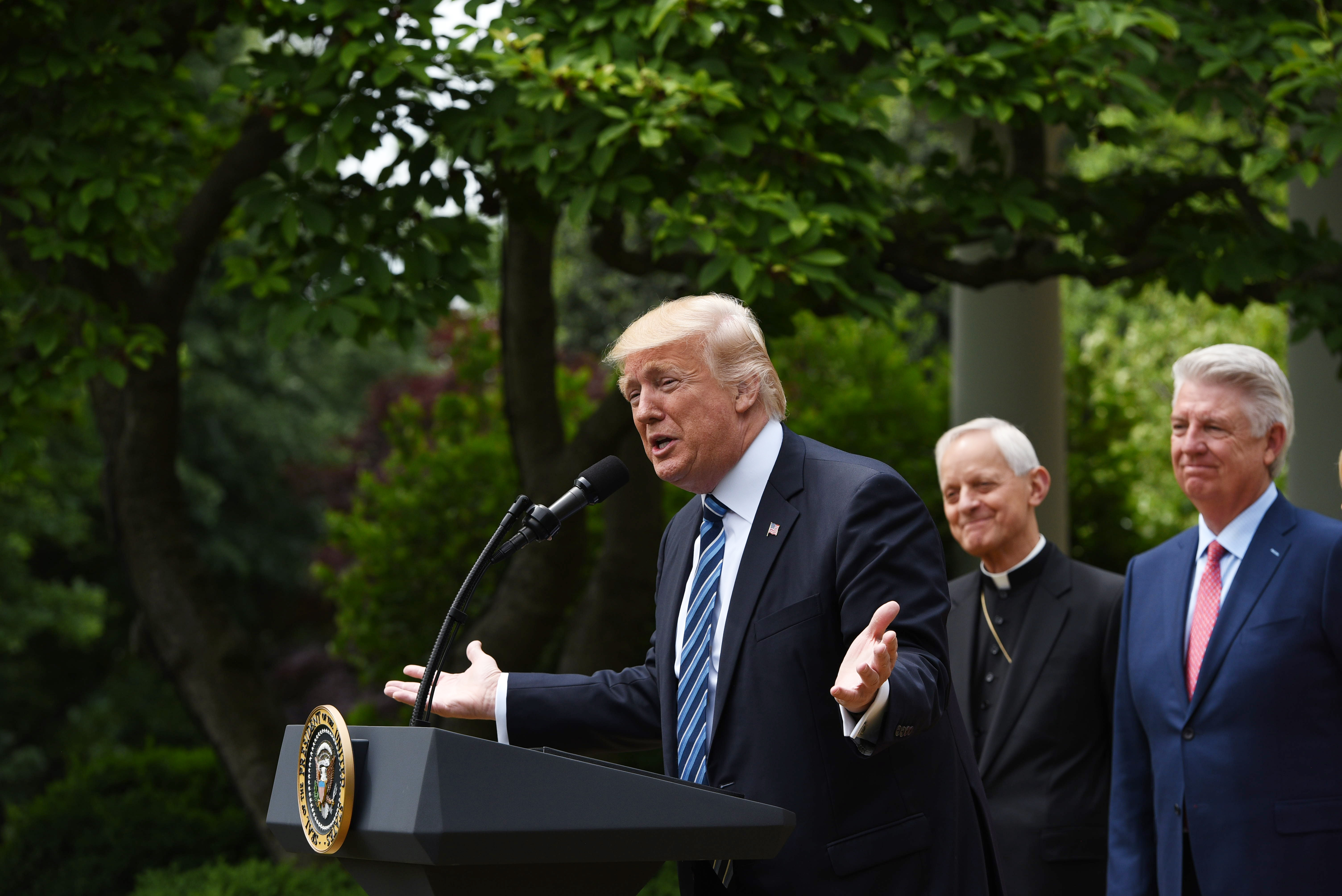 US President Donald Trump speaks before signing an Executive Order on Promoting Free Speech and Religious Liberty in the Rose Garden of the White House on May 4, 2017 in Washington, DC.                     Trump issued an executive order on Thursday making it easier for churches and religious groups to take part in politics without risk of losing their tax-exempt status, a senior White House official said. / AFP PHOTO / Mandel Ngan        (Photo credit should read MANDEL NGAN/AFP/Getty Images)