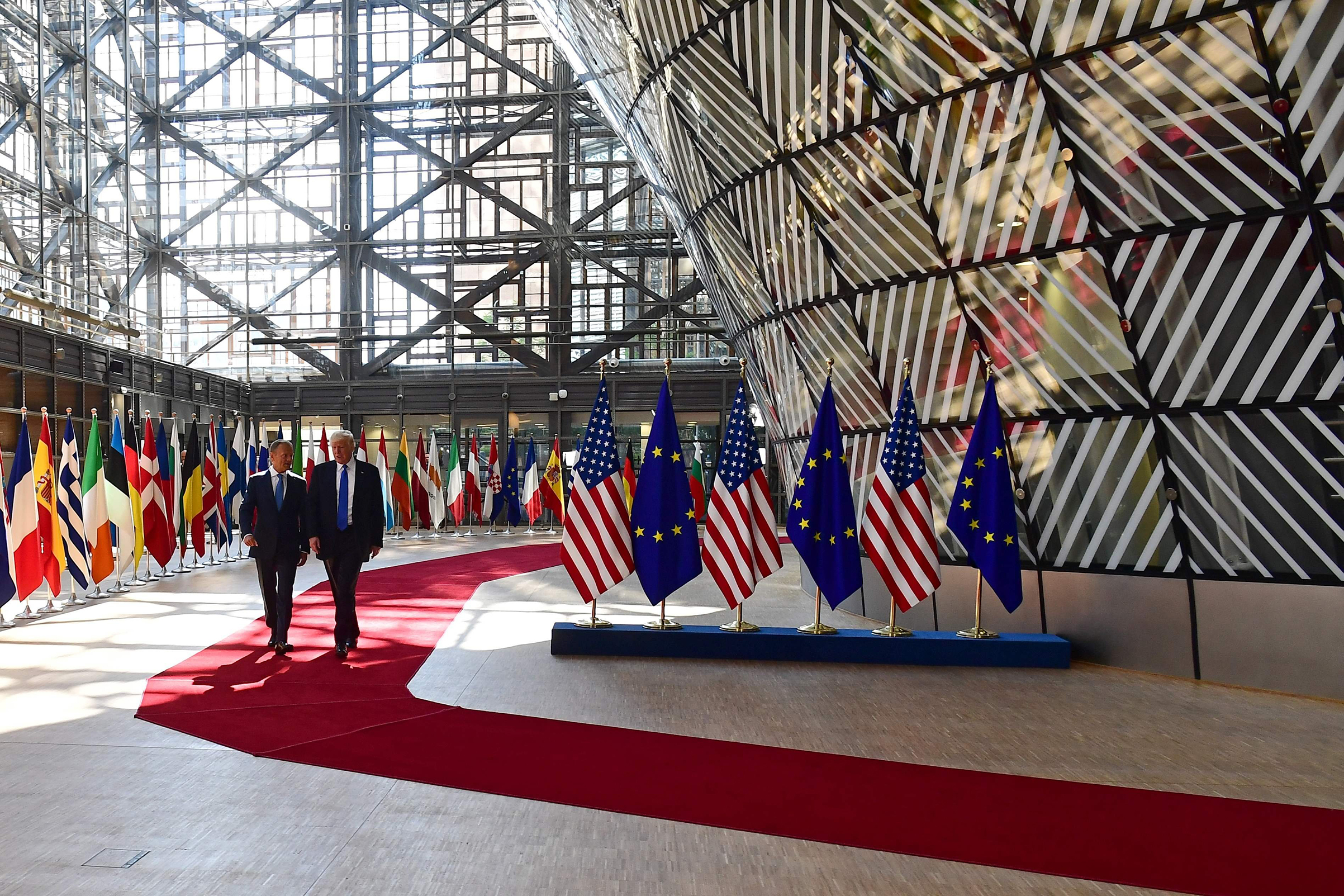 European Council President Donald Tusk speaks to President Trump after welcoming him at the E.U. headquarters, as part of the NATO meeting, in Brussels on May 25, 2017.