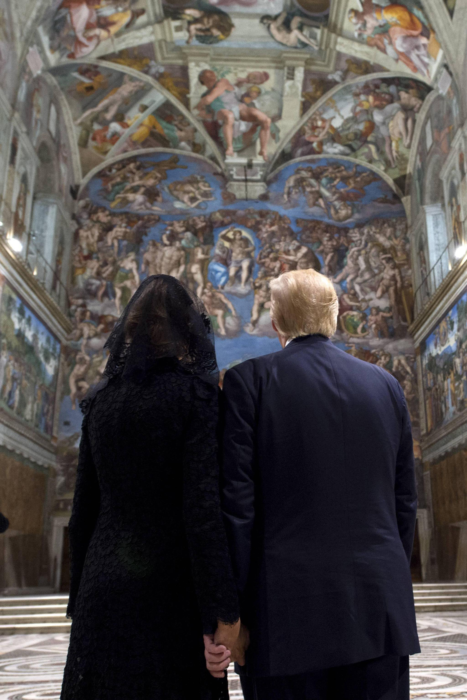 President Trump and First Lady Melania Trump admire the frescoed ceilings during their visit to the Sistine Chapel at the Vatican on May 24, 2017.