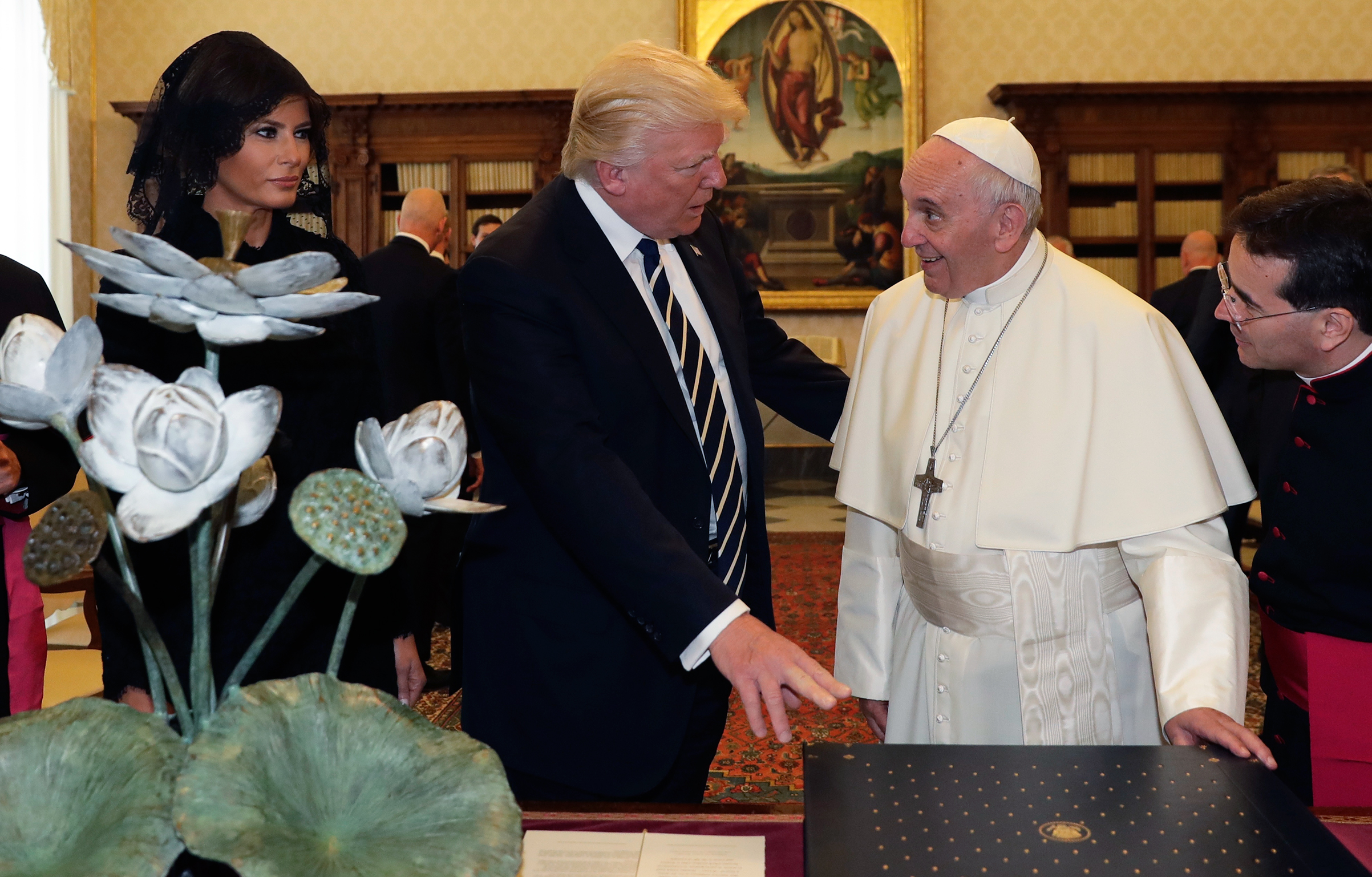Pope Francis exchanges gifts with President Trump and First Lady Melania Trump at the Vatican on May 24, 2017.