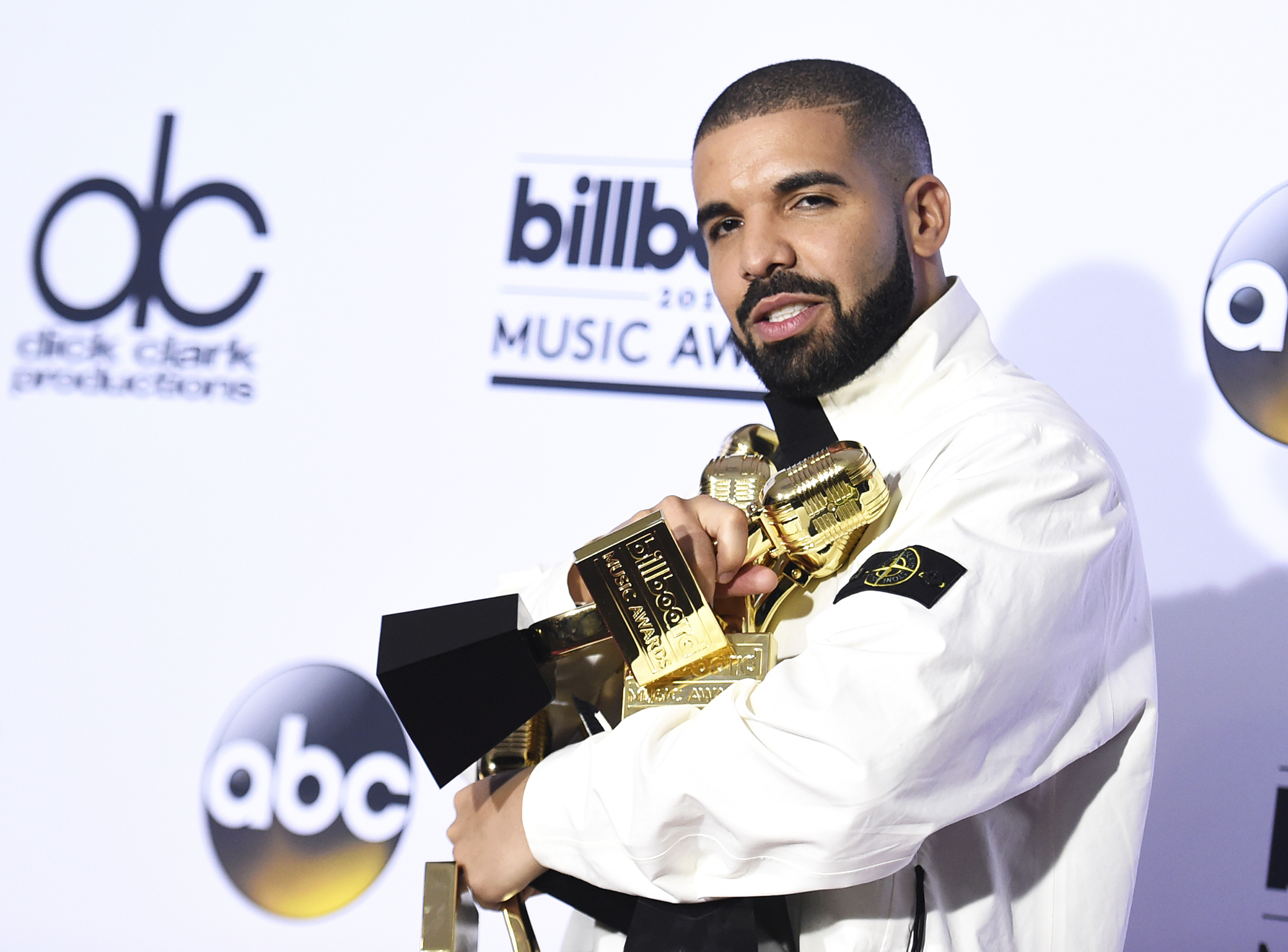 Drake poses in the press room with his 13 awards at the Billboard Music Awards, on May 21, 2017 in Las Vegas.