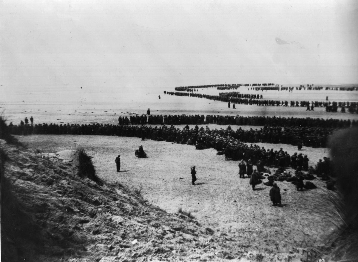 British and French troops waiting on the dunes at Dunkirk to be picked up by the Destroyers and taken back to England, May 1940.