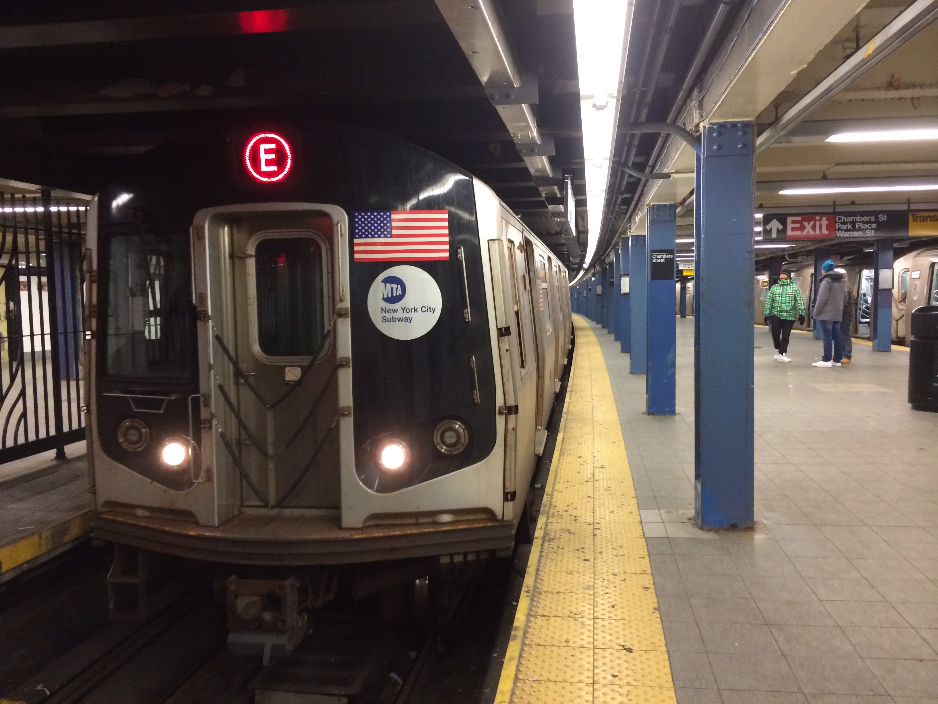 E train arrives at World Trade Center subway station .