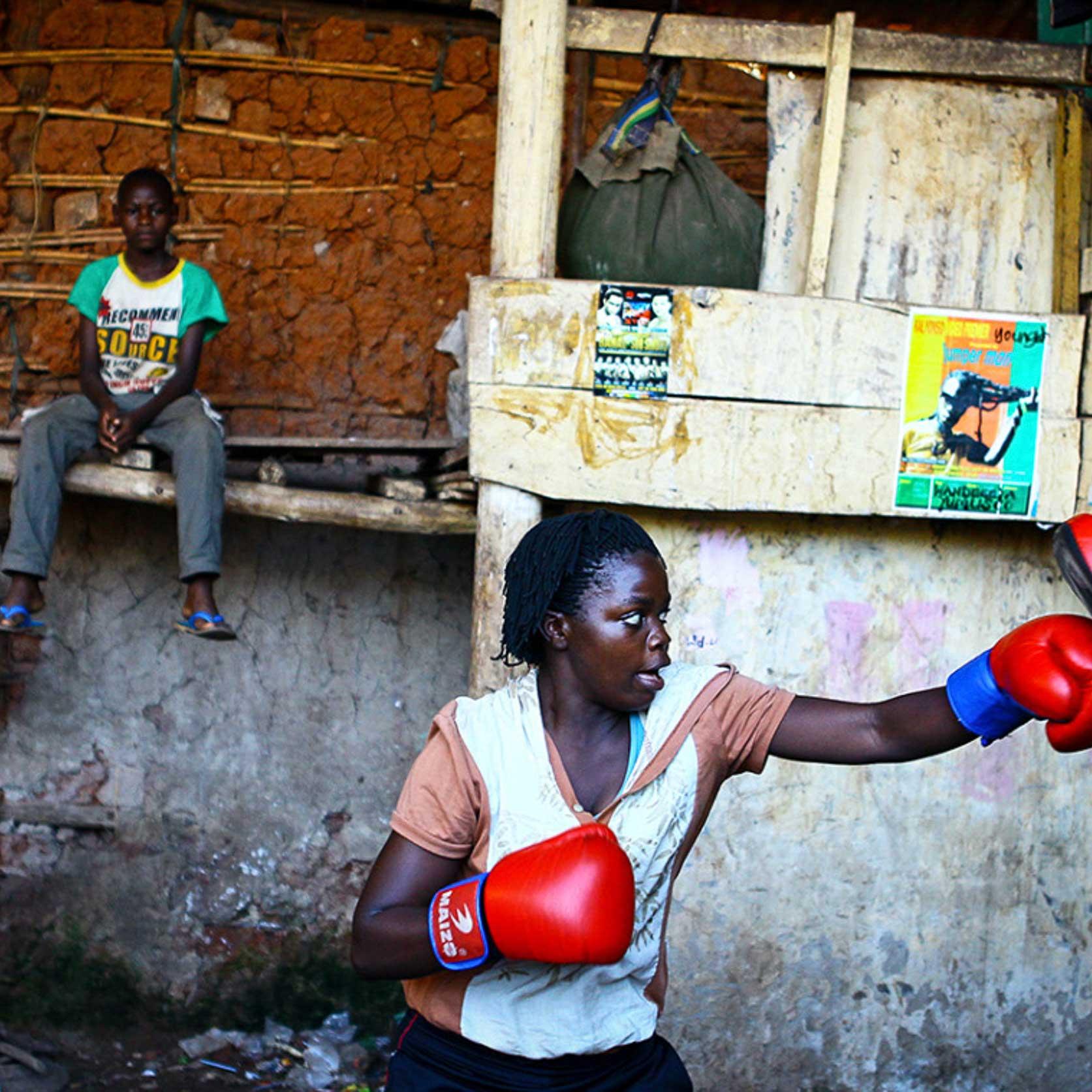 A female boxer trains inside a makeshift gym in Katanga, Kampala, Uganda.
