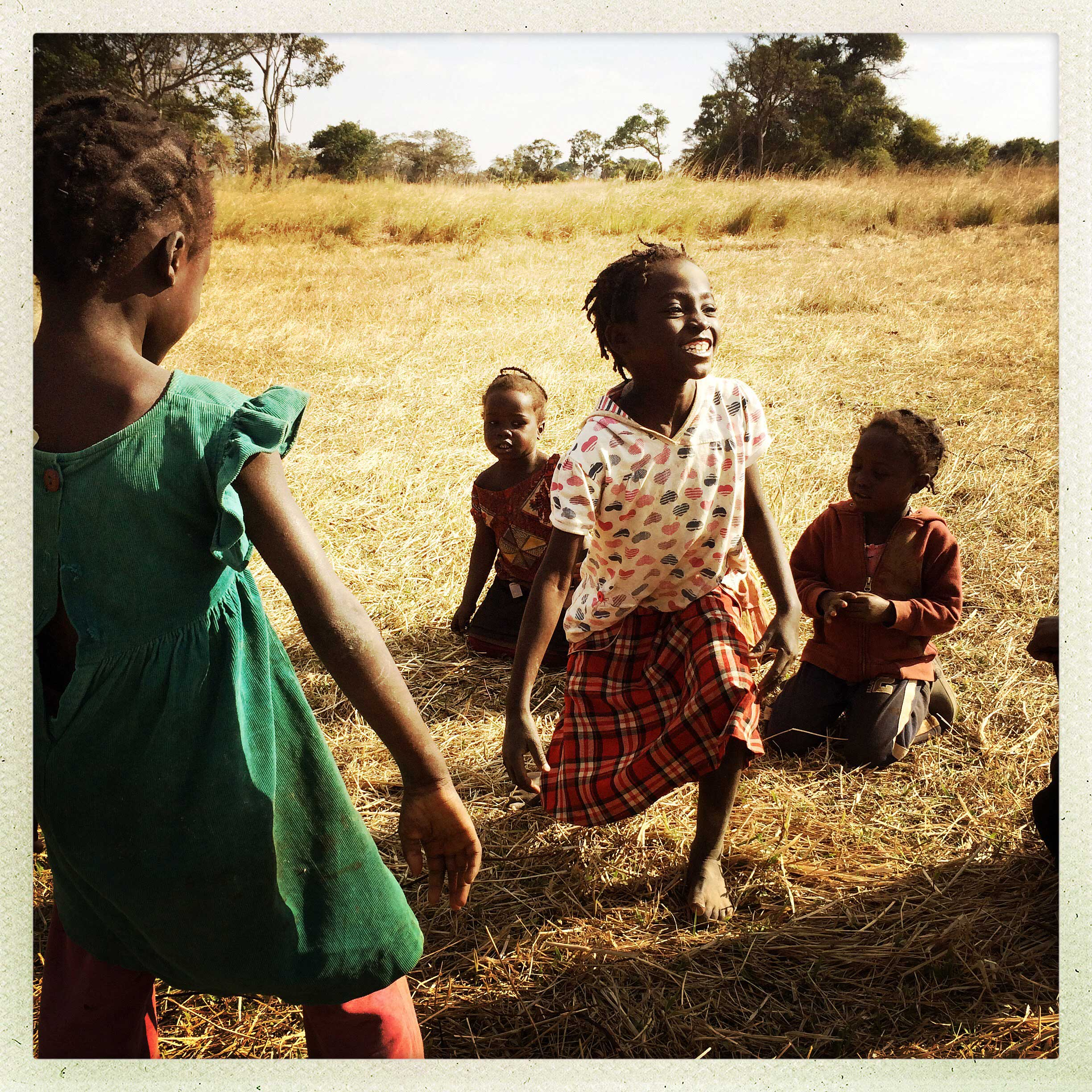 Girls play an afternoon dancing game in a village outside Kabwe, Zambia. Many of the people here are subsistence farmers who grow tomatoes, cabbage, kale, and other food.