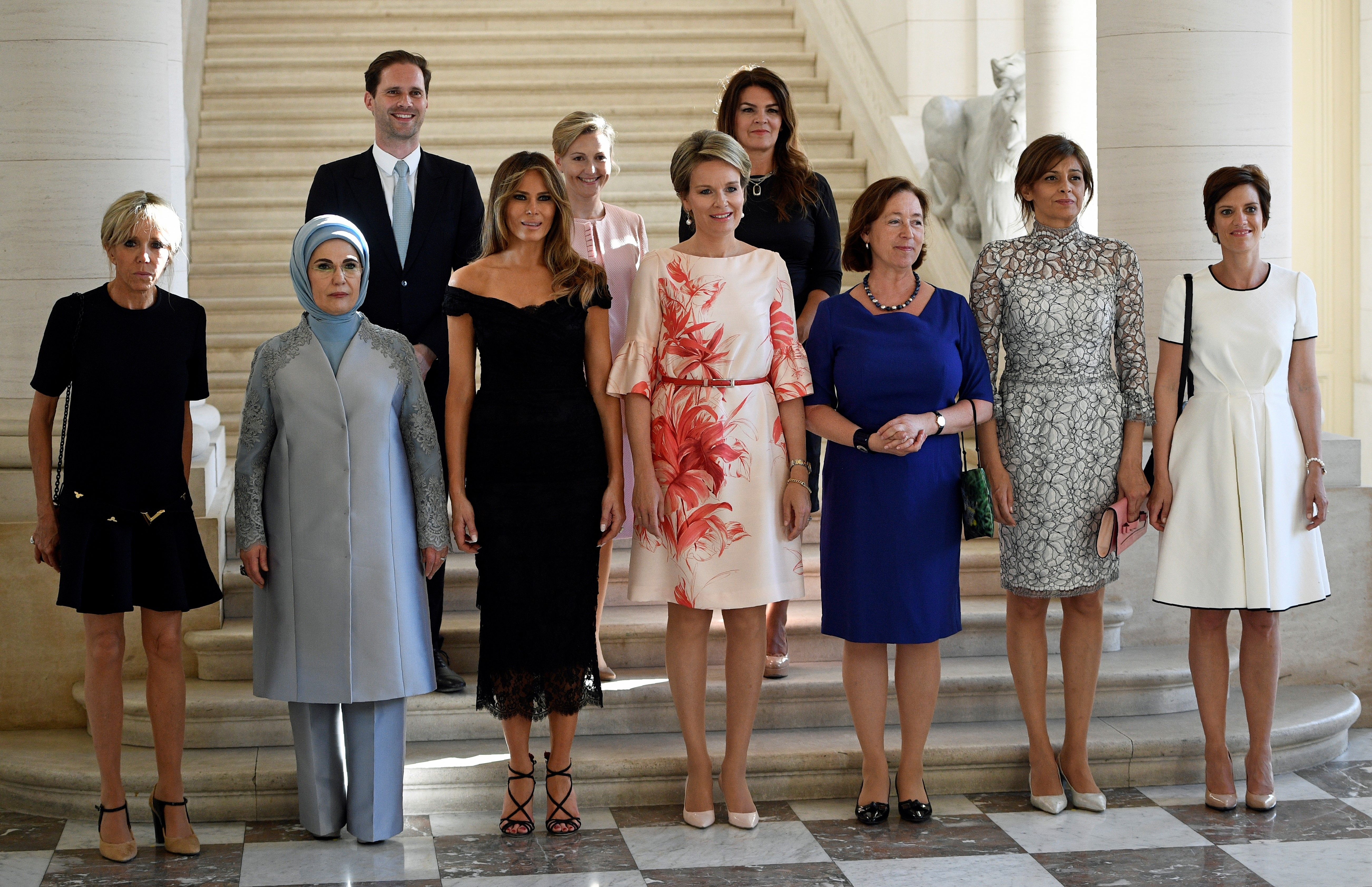 (Front row LtoR) Brigitte Macron, wife of French President, Emine Gulbaran Erdogan, wife of Turkey's President, First Lady of the US Melania Trump, Queen Mathilde of Belgium, Stoltenberg's wife Ingrid Schulerud, partner of Bulgaria's President Desislava Radeva, partner of Charles Michel Amelie Derbaudrenghien, (back row, LtoR), husband of Luxembourg's prime minister Gauthier Destenay, partner of Slovenia's Prime Minister Mojca Stropnik and wife of Iceland's President Thora Margret Baldvinsdottir pose for a family photo before a diner  at the Royal castle in Laken/Laeken, on May 25, 2017, in Brussels. / AFP PHOTO / BELGA / YORICK JANSENS / Belgium OUT        (Photo credit should read YORICK JANSENS/AFP/Getty Images)