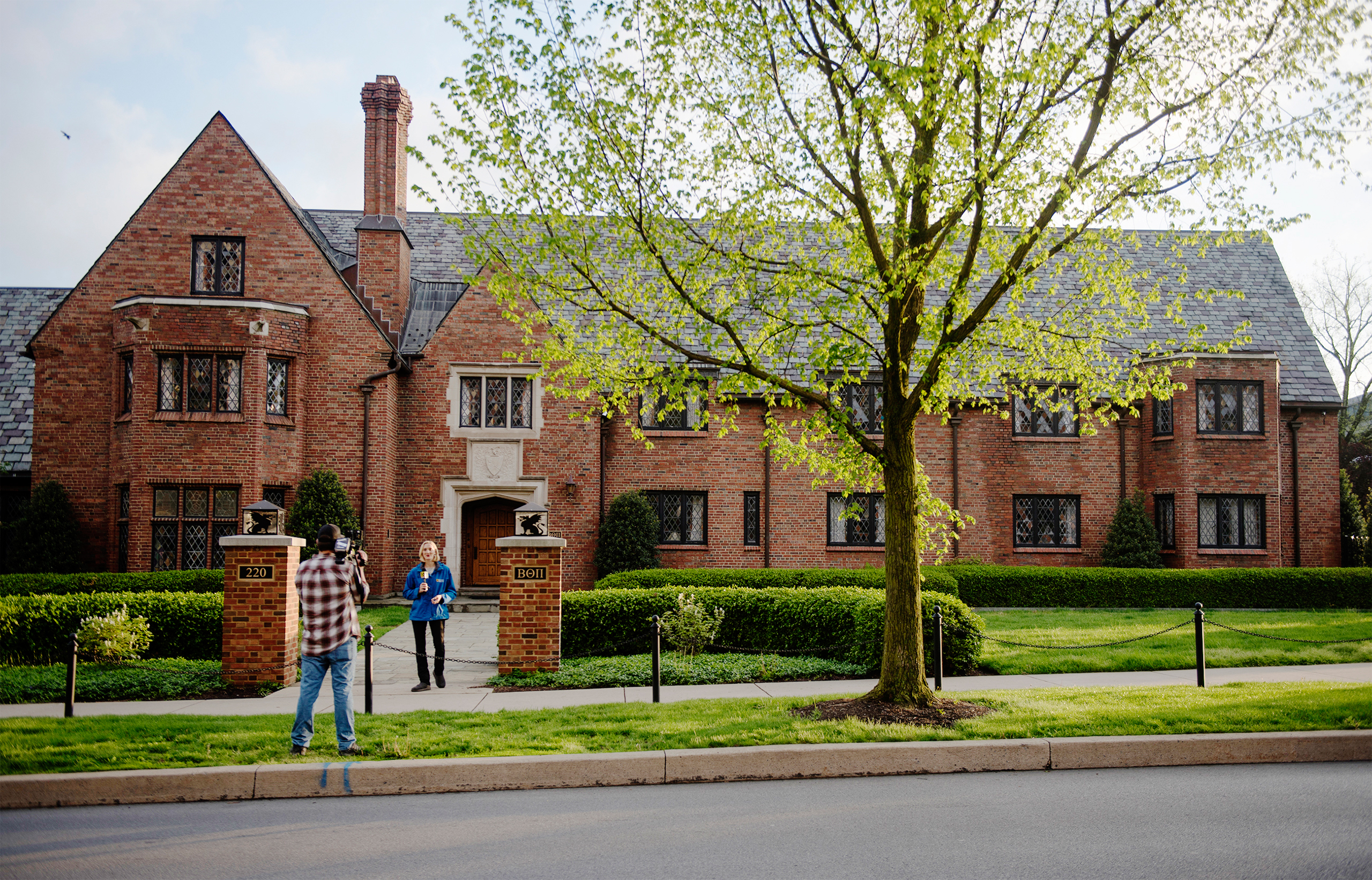 Reporters shoot a news standup outside the Penn State University Beta Theta Pi fraternity house on campus on May 5, 2017 in State College.