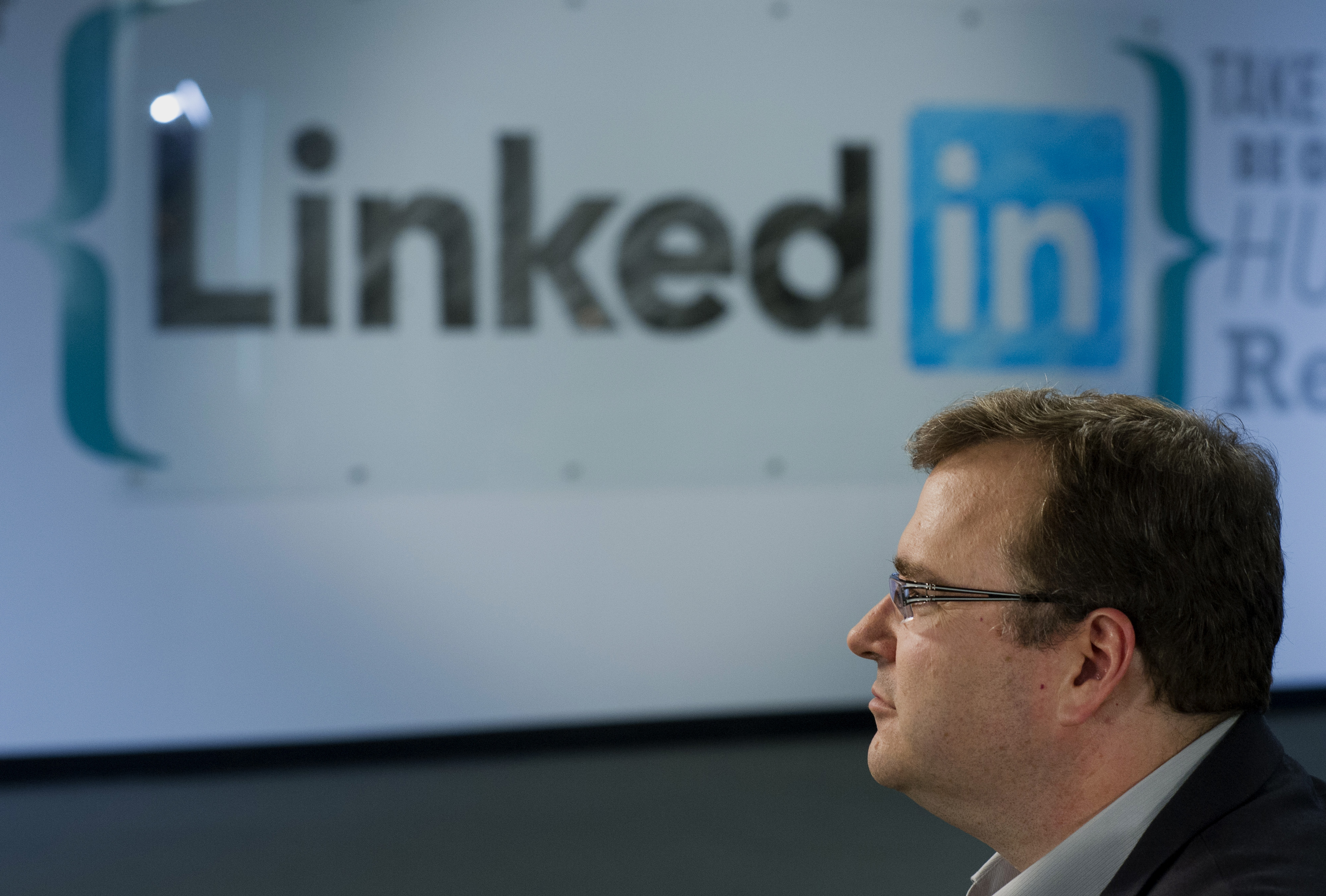 Reid Hoffman, chairman and co-founder of LinkedIn Corp., pauses during a Bloomberg Television interview in Sunnyvale, California, U.S., on Thursday, June 12, 2014. LinkedIn announced last week that users will soon have more design license over their profile pages, with the option of adding stock images or a custom backdrop - similar to what's already available on Facebook and Twitter. Photographer: David Paul Morris/Bloomberg via Getty Images