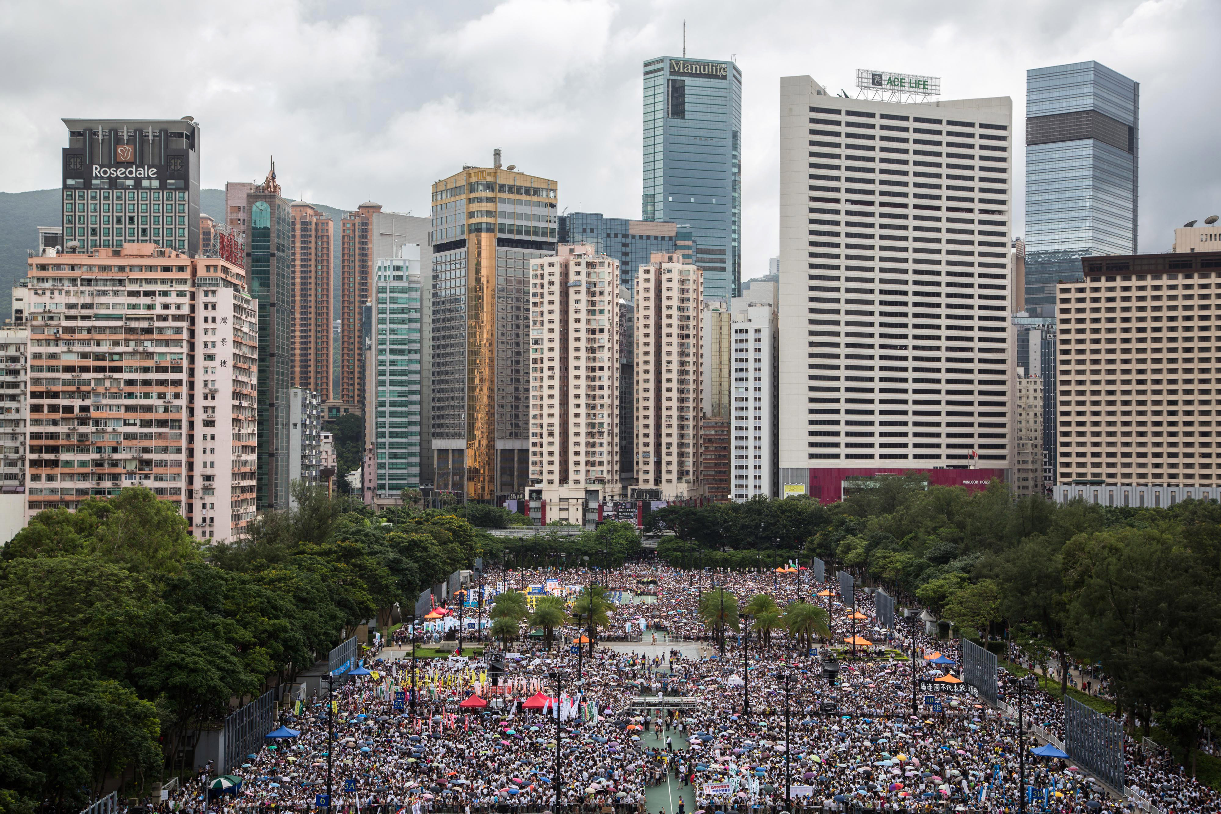 Protesters congregate at Victoria Park ahead of a rally in Hong Kong on Tuesday, July 1, 2014.