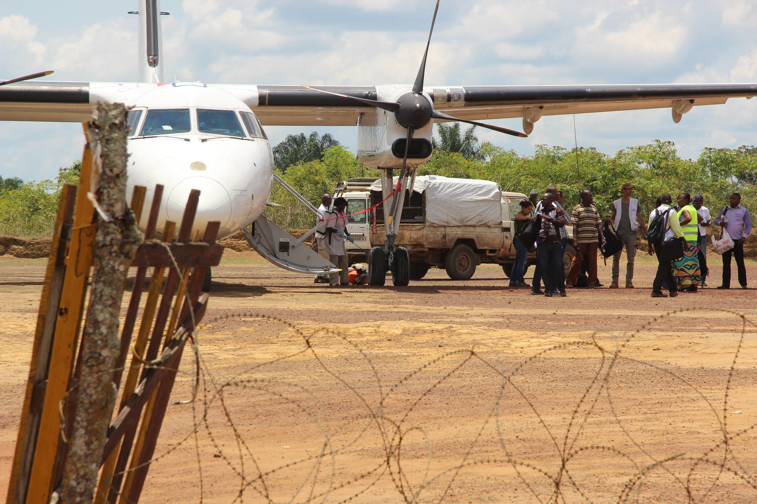 Luggages get disinfected after a plane's arrival at Boende's airport, on October 8, 2014, as part of prophylactic measures against the spread of the Ebola virus.