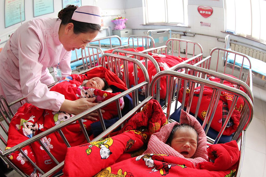 A nurse takes care of new born babies at People's Hospital of Ganyu on October 1, 2013 in Lianyungang, China.