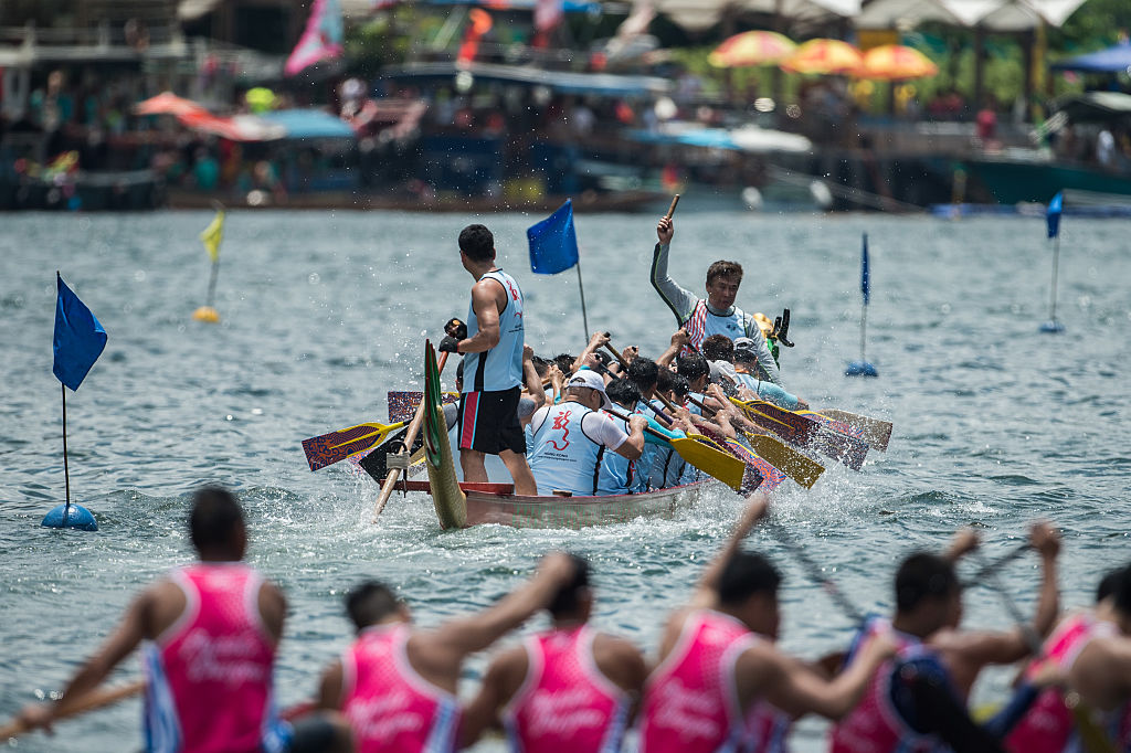 A drummer keeps the rhythm for his teammates as they take part in dragon boat races held to celebrate the Tuen Ng festival in Hong Kong on June 9, 2016.