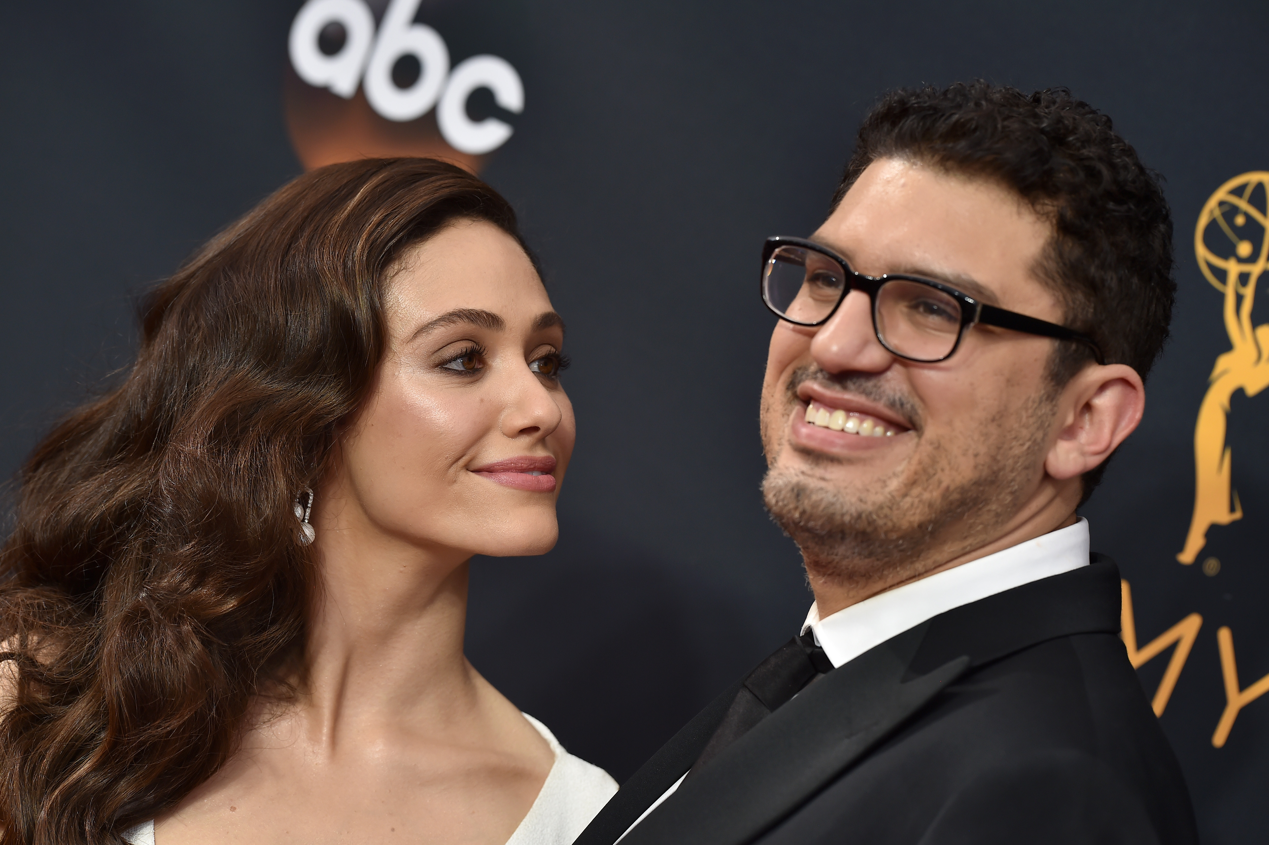 Actress Emmy Rossum (L) and writer/producer Sam Esmail arrive at the 68th Annual Primetime Emmy Awards at Microsoft Theater on September 18, 2016 in Los Angeles, California.