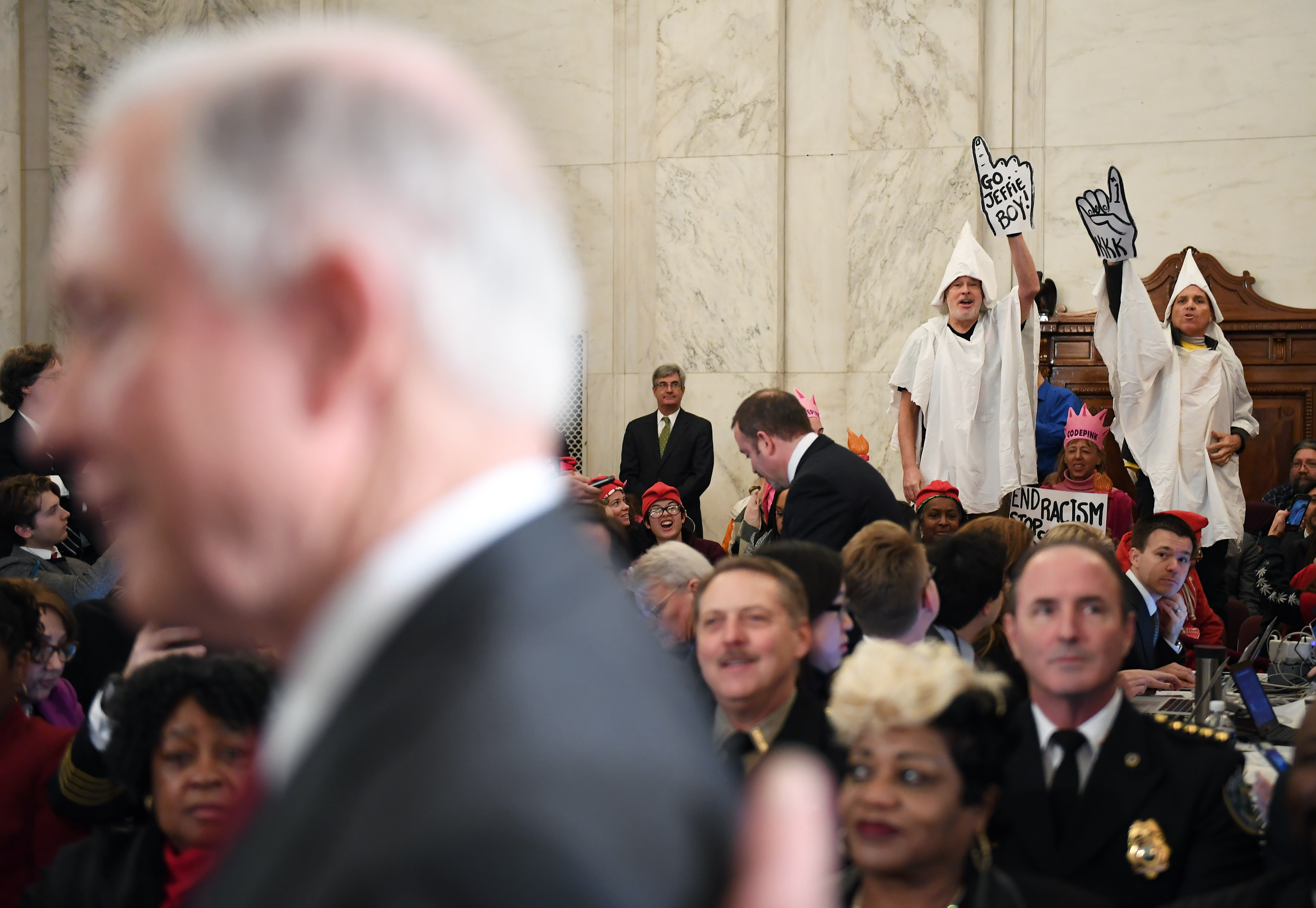 Senator Jeff Sessions (R-AL) is seen before his Attorney General confirmation hearing as Code Pink demonstrators dressed as KKK members stand up and call to the Senator at the Russell Senate Office Building on Tuesday January 10, 2017 in Washington, DC.
