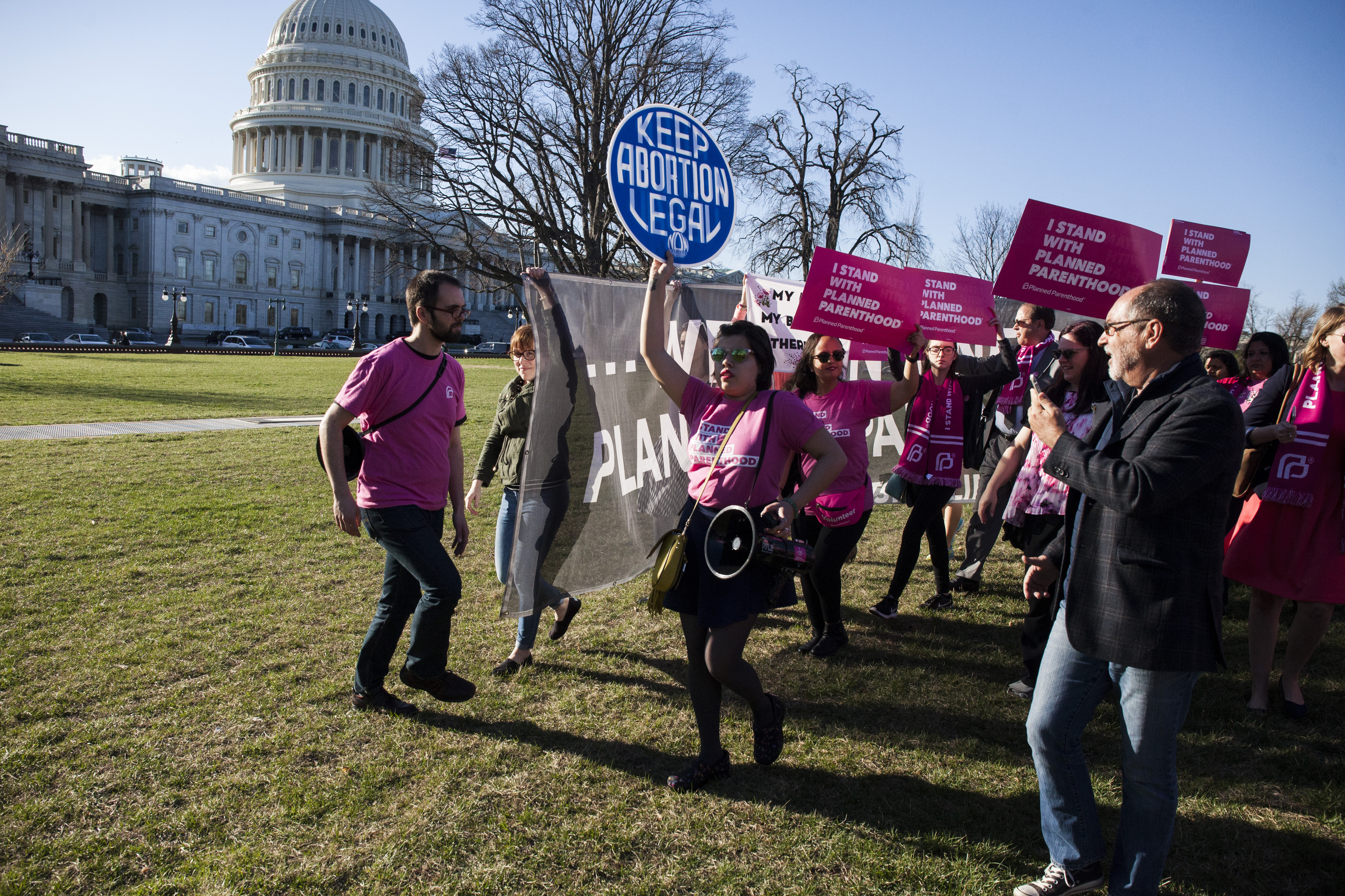 Demonstrators attempt to block a sign held by abortion opponents during a rally opposing attempts to defund Planned Parenthood March 29, 2017 on Capitol Hill in Washington, DC. U.S. (Zach Gibson--Getty Images)