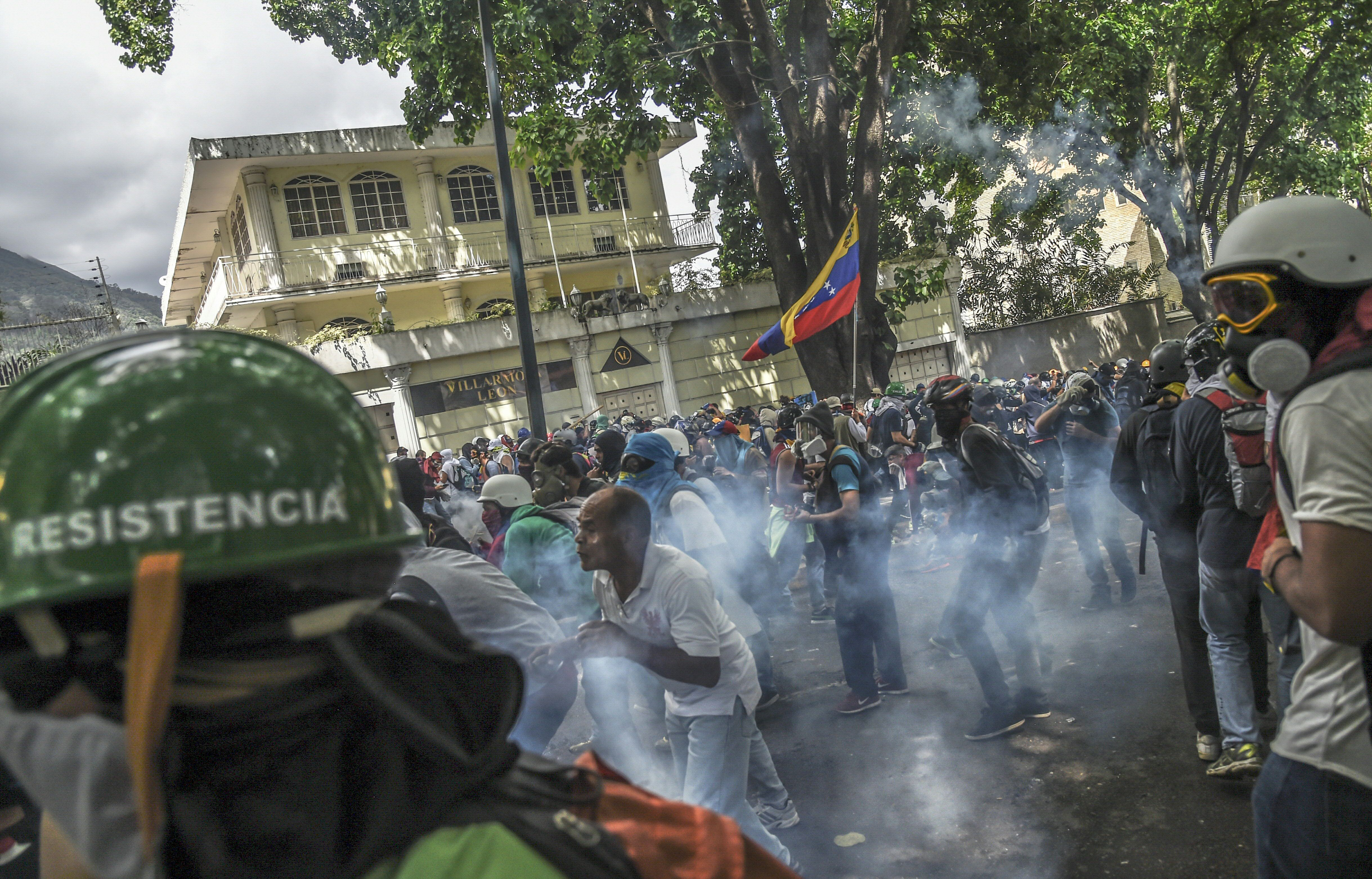 Opposition activists clash with riot police during a march against Venezuelan President Nicolas Maduro held on May Day in Caracas, May 1, 2017.