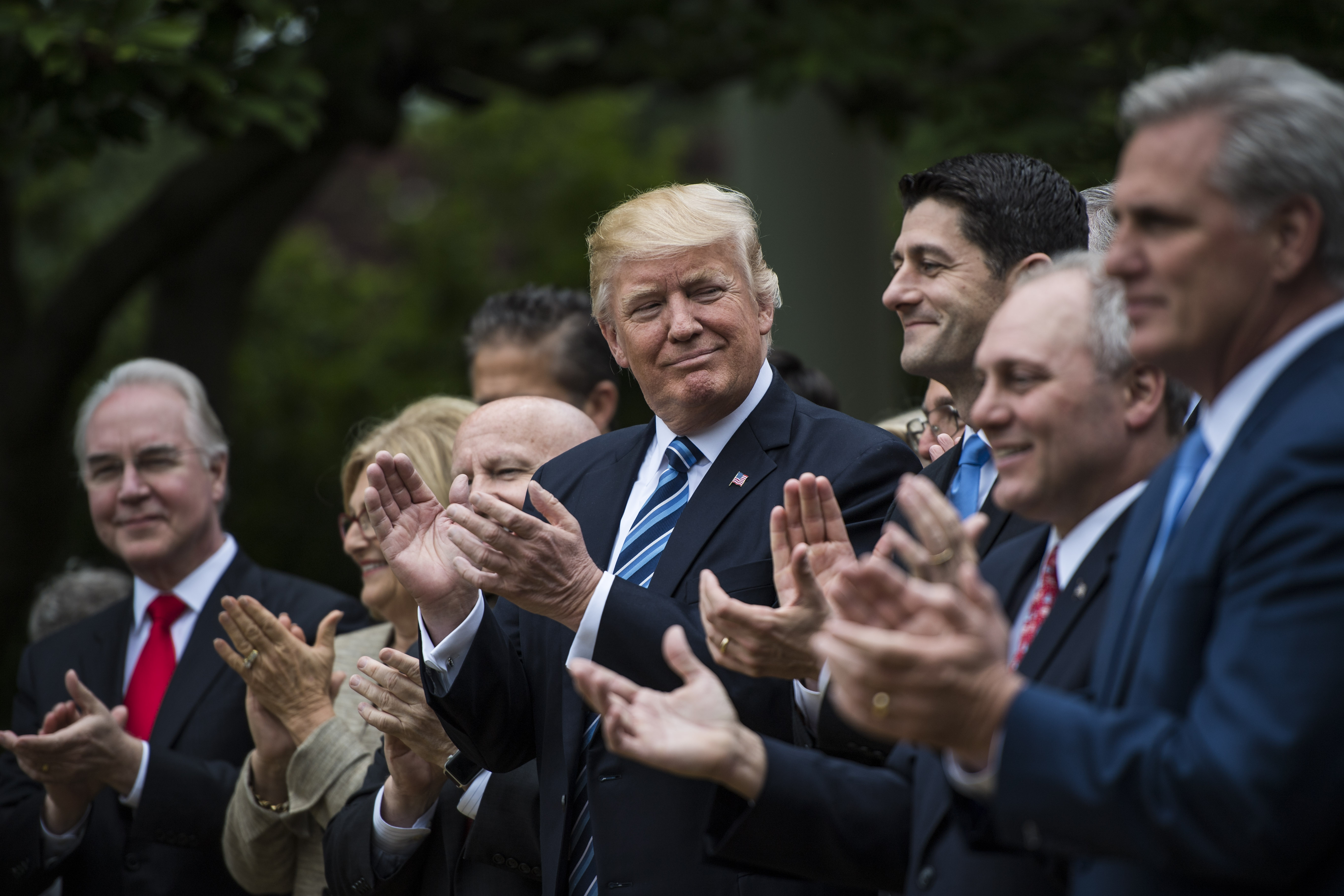 President Donald Trump looks to House Speaker Paul Ryan of Wis., and other House congressmen in the Rose Garden after the House pushed through a health care bill, at the White House in Washington, DC on Thursday, May 04, 2017.
