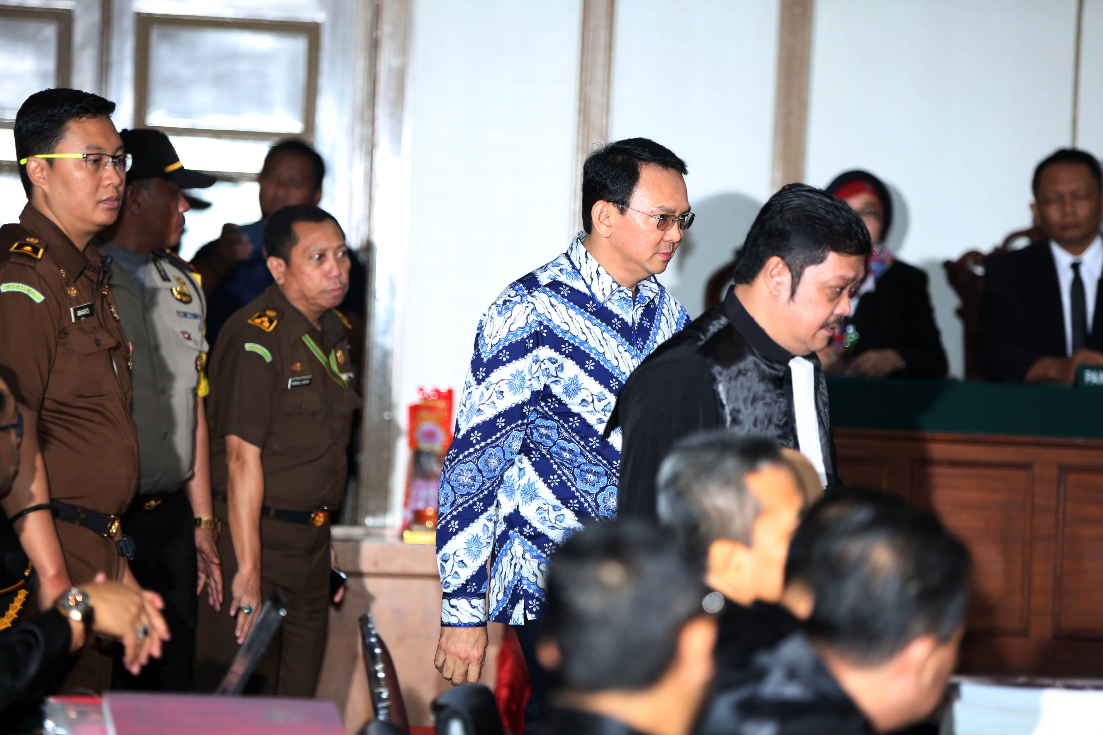 Jakarta Governor Basuki Tjahaja Purnama, popularly known as Ahok, arrives at a courtroom for his verdict and sentence in his blasphemy trial in Jakarta on May 9, 2017, in Jakarta