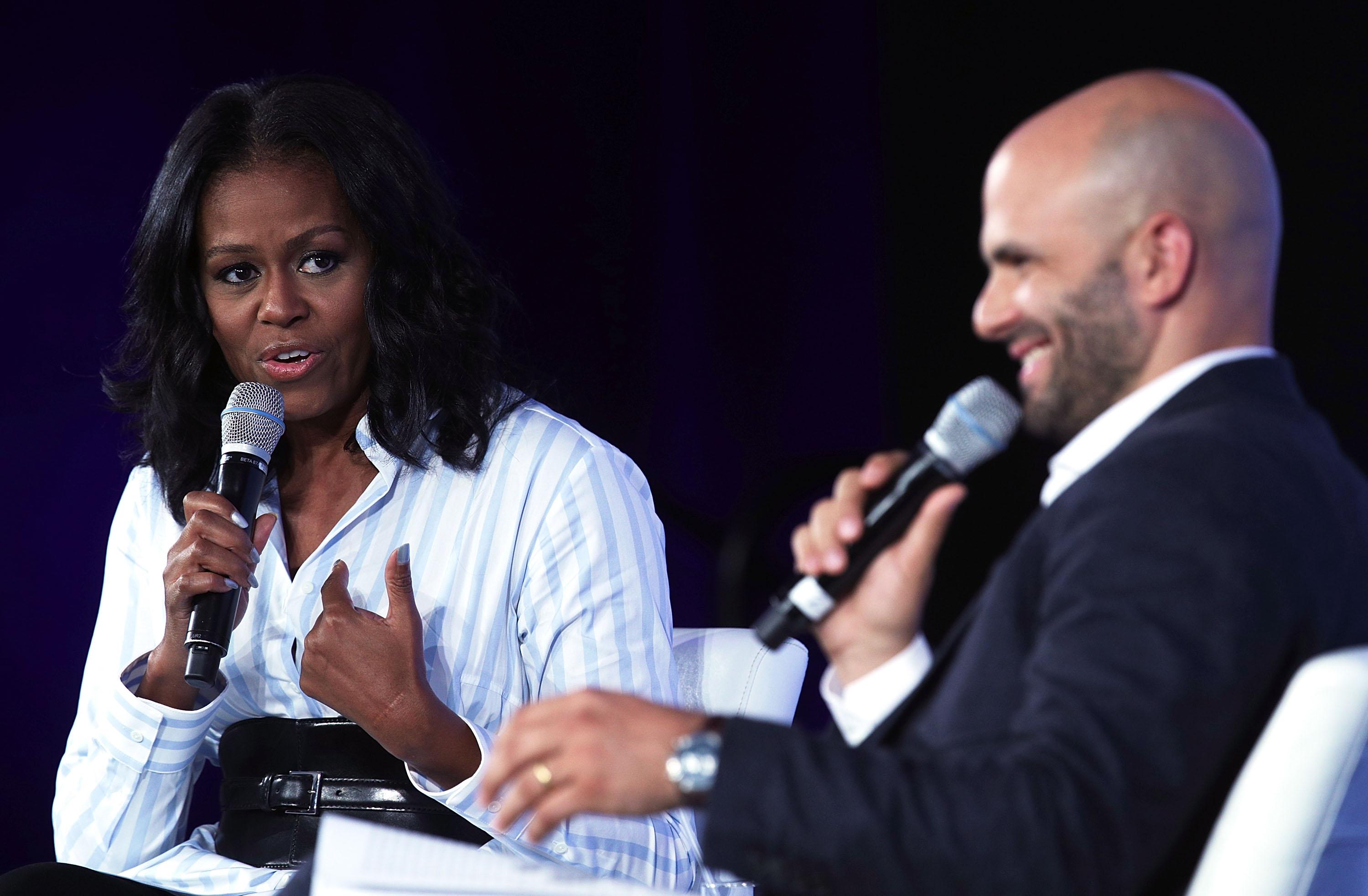 WASHINGTON, DC - MAY 12:  Former First Lady Michelle Obama (L) participates in a discussion with former White House chef and Senior Policy Advisor for Nutrition Policy Sam Kass (R) during the Partnership for a Healthier America Summit May 12, 2017 in Washington, DC. The PHA held its summit to address childhood obesity.  (Photo by Alex Wong/Getty Images)