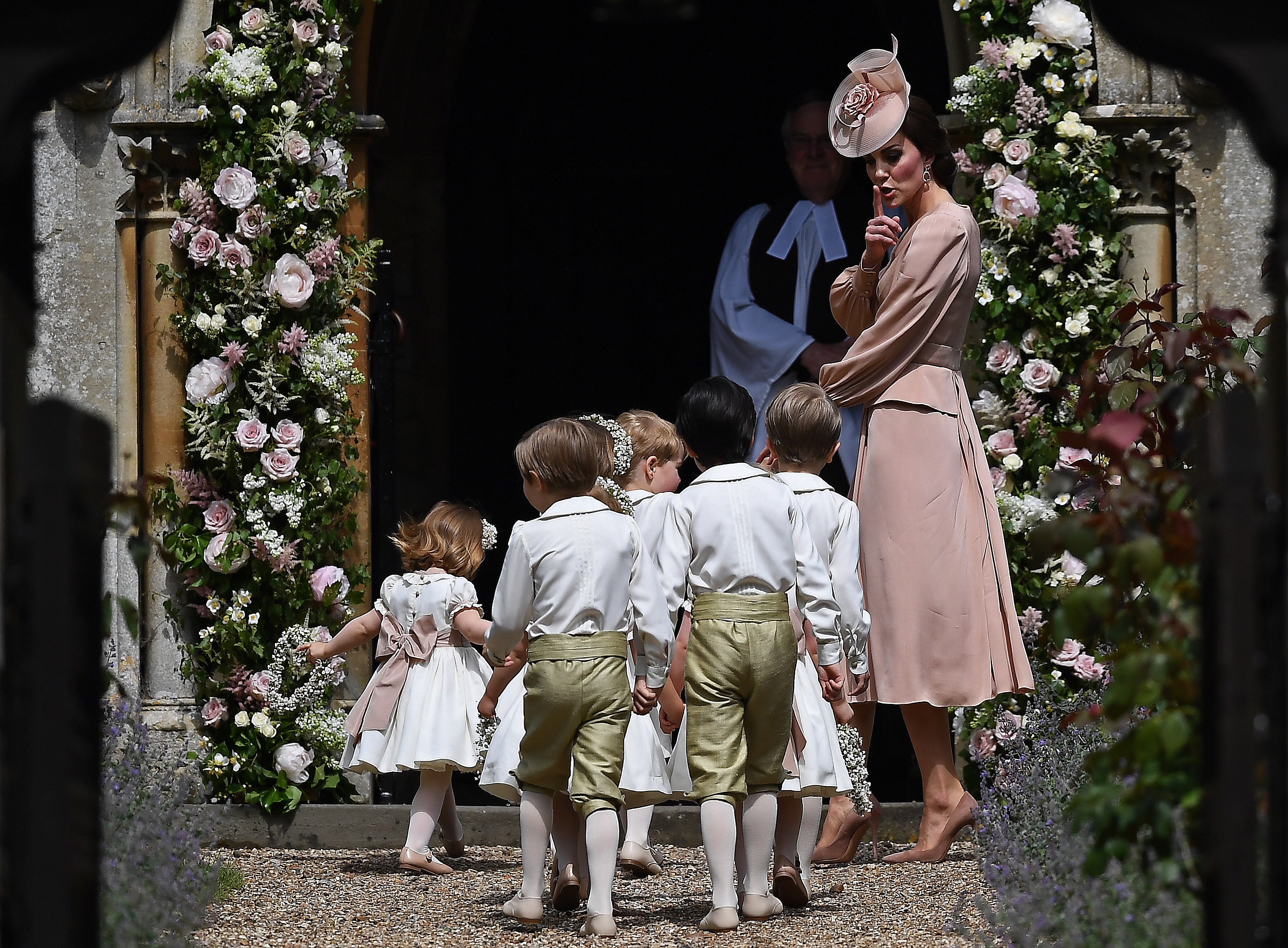 Britain's Catherine, Duchess of Cambridge walks with the bridesmaids and pageboys as they arrive as they arrive for her sister Pippa Middleton's wedding to James Matthews at St Mark's Church on May 20, 2017 in Englefield Green, England.