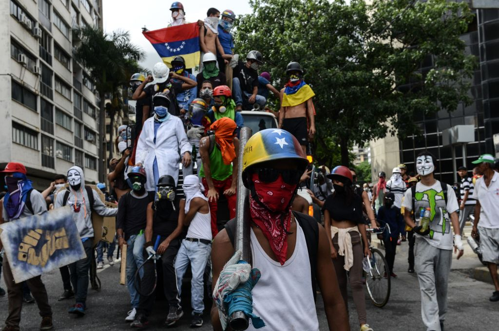 Opposition activists clash with riot policemen during a protest against the government of Venezuelan President Nicolas Maduro, in Caracas on May 22, 2017.