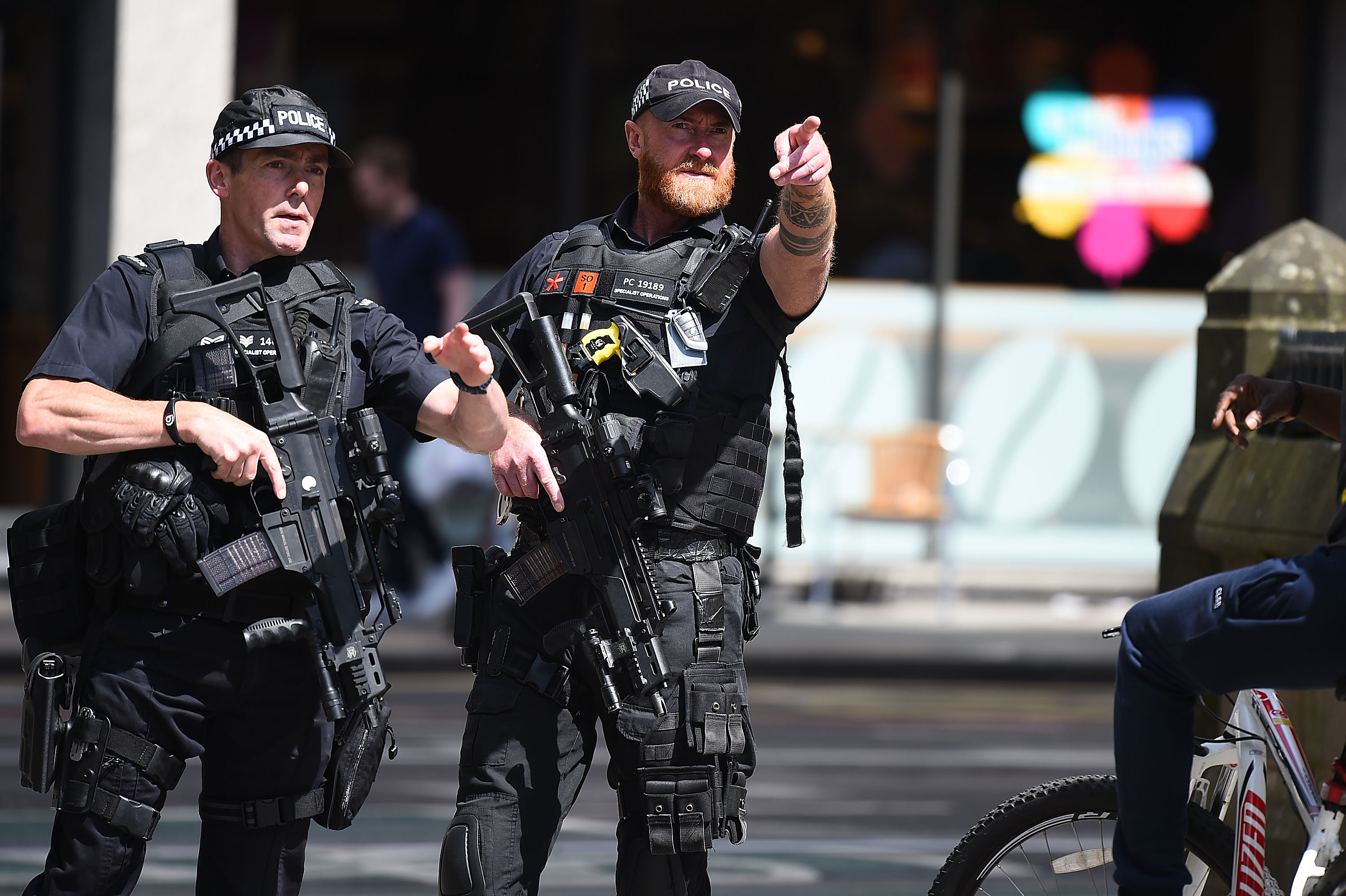 Police stand guard near the Manchester Arena on May 23, 2017 in Manchester, England.