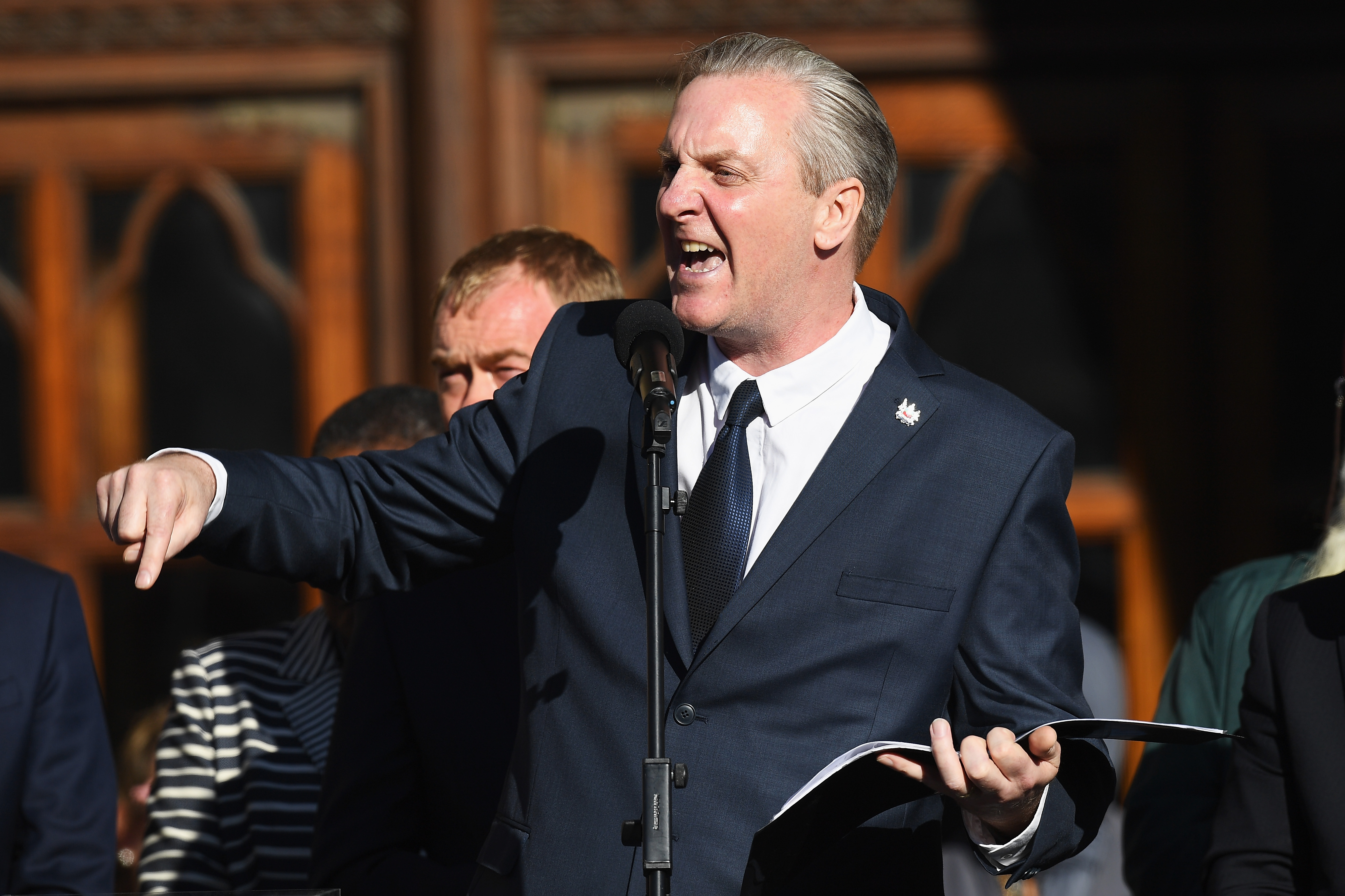 Poet Tony Walsh speaks as members of the public gather at a vigil, to honour the victims of Monday evening's terror attack, at Albert Square on May 23, 2017 in Manchester, England.