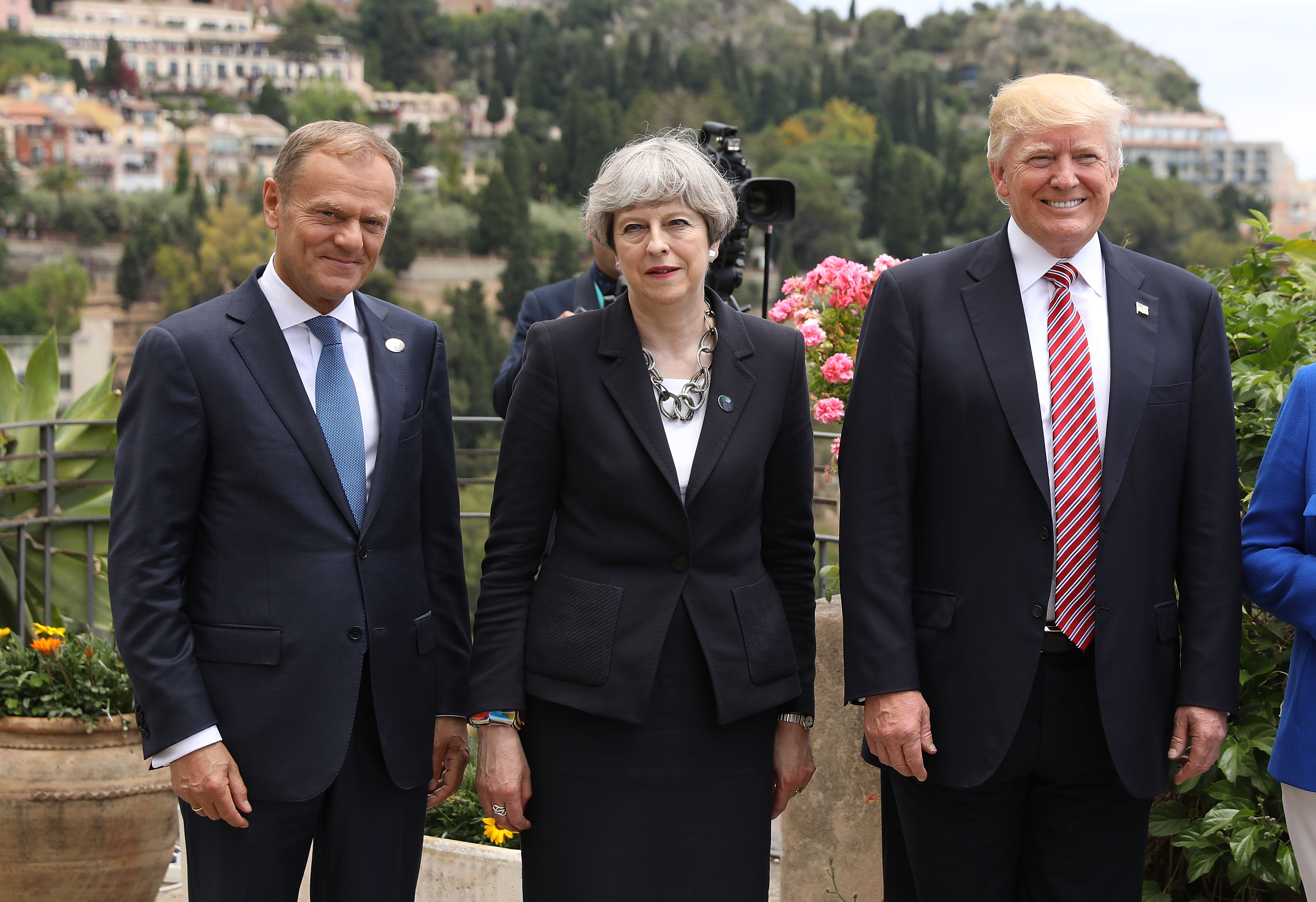 G7 leaders European Council President Donald Tusk, British Prime Minister Theresa May and U.S. President Donald Trump attend a flypast at San Domenico Palace Hotel on May 26, 2017 in Taormina , Italy.