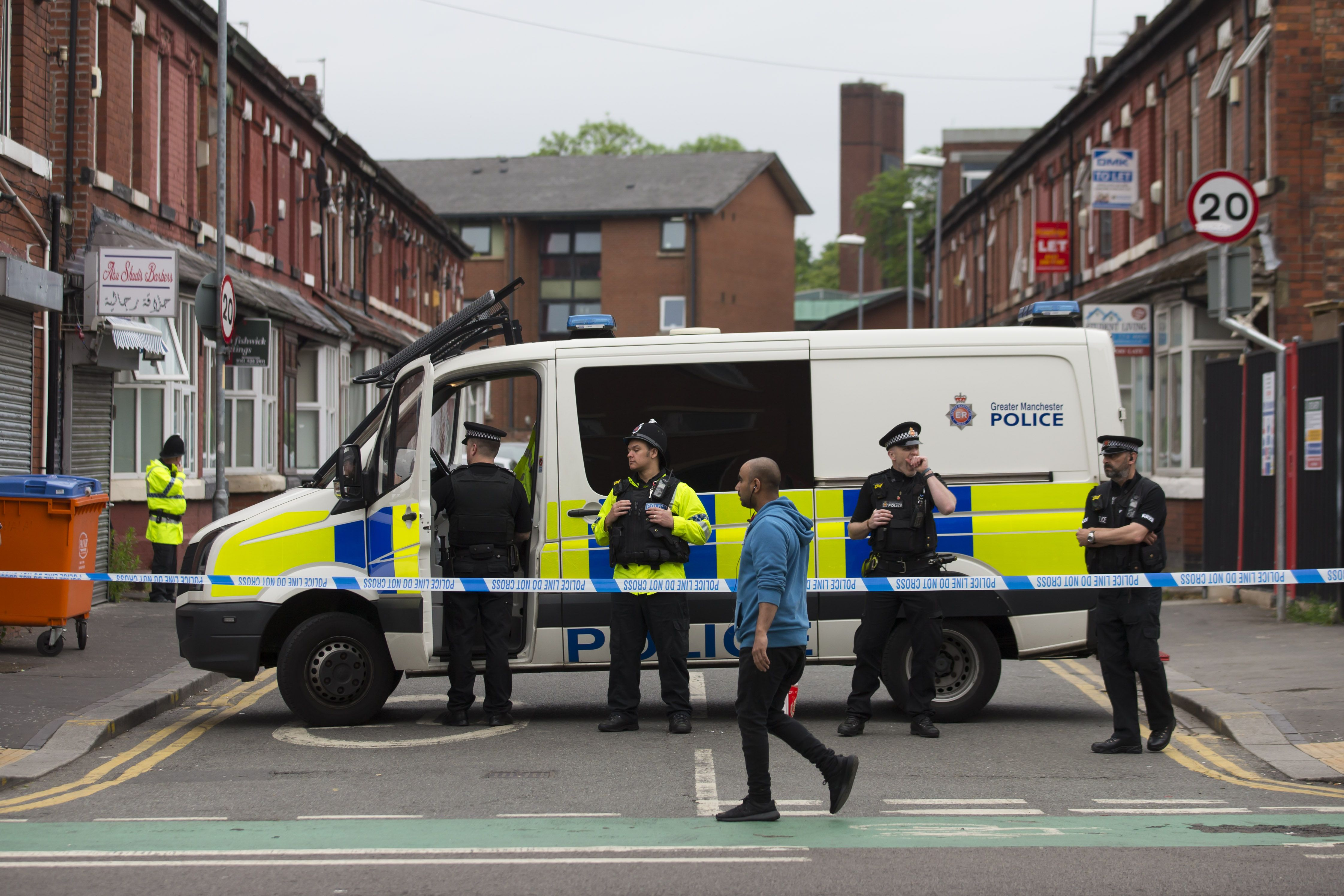 Police officers stand guard on May 29, 2017, as they continue their investigations in the wake of the May 22 Manchester Arena bomb attack.