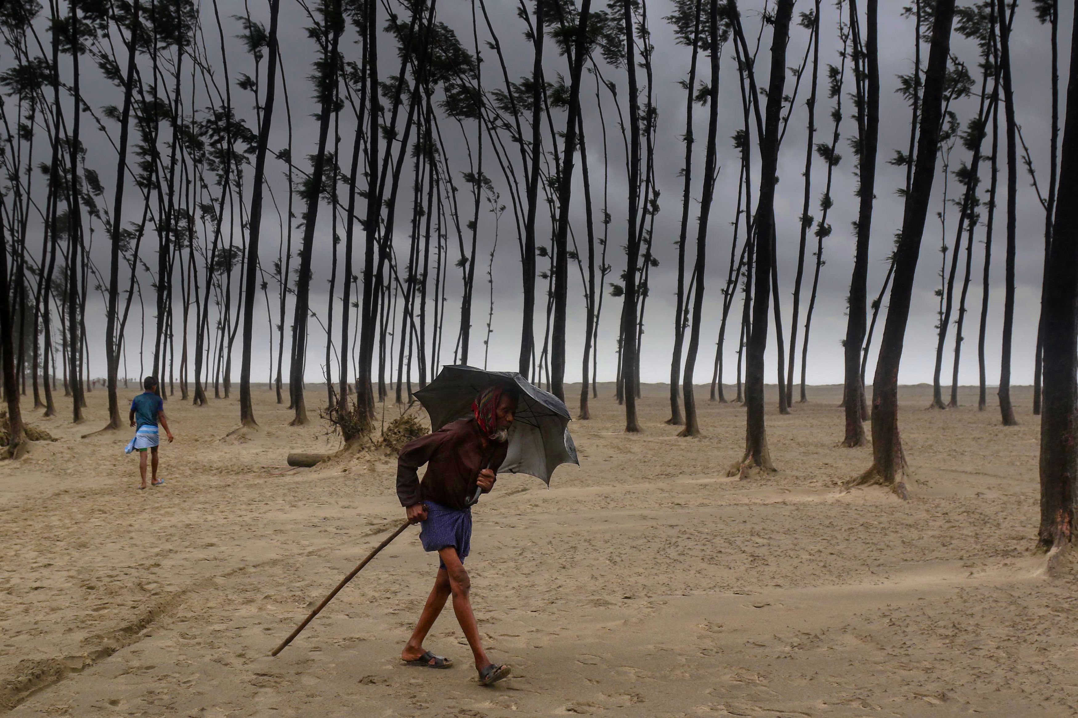 A Bangladeshi villager evacuates to a cyclone shelter on the coast in Cox's Bazar district on May 30, 2017.