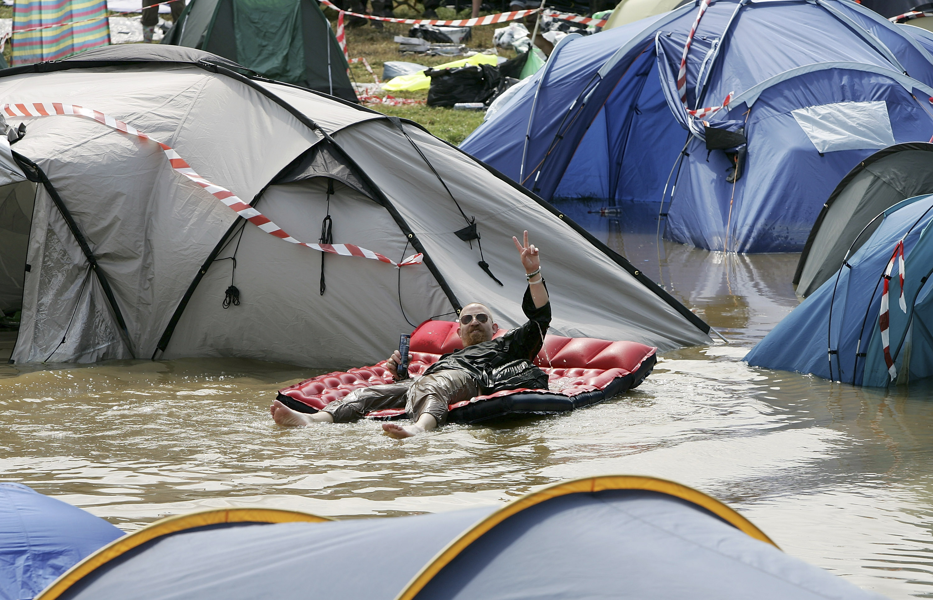 A camp site flooded by heavy rain on the first day of the Glastonbury Music Festival 2005 at Worthy Farm, Pilton, June 24, 2005 in Somerset, England.