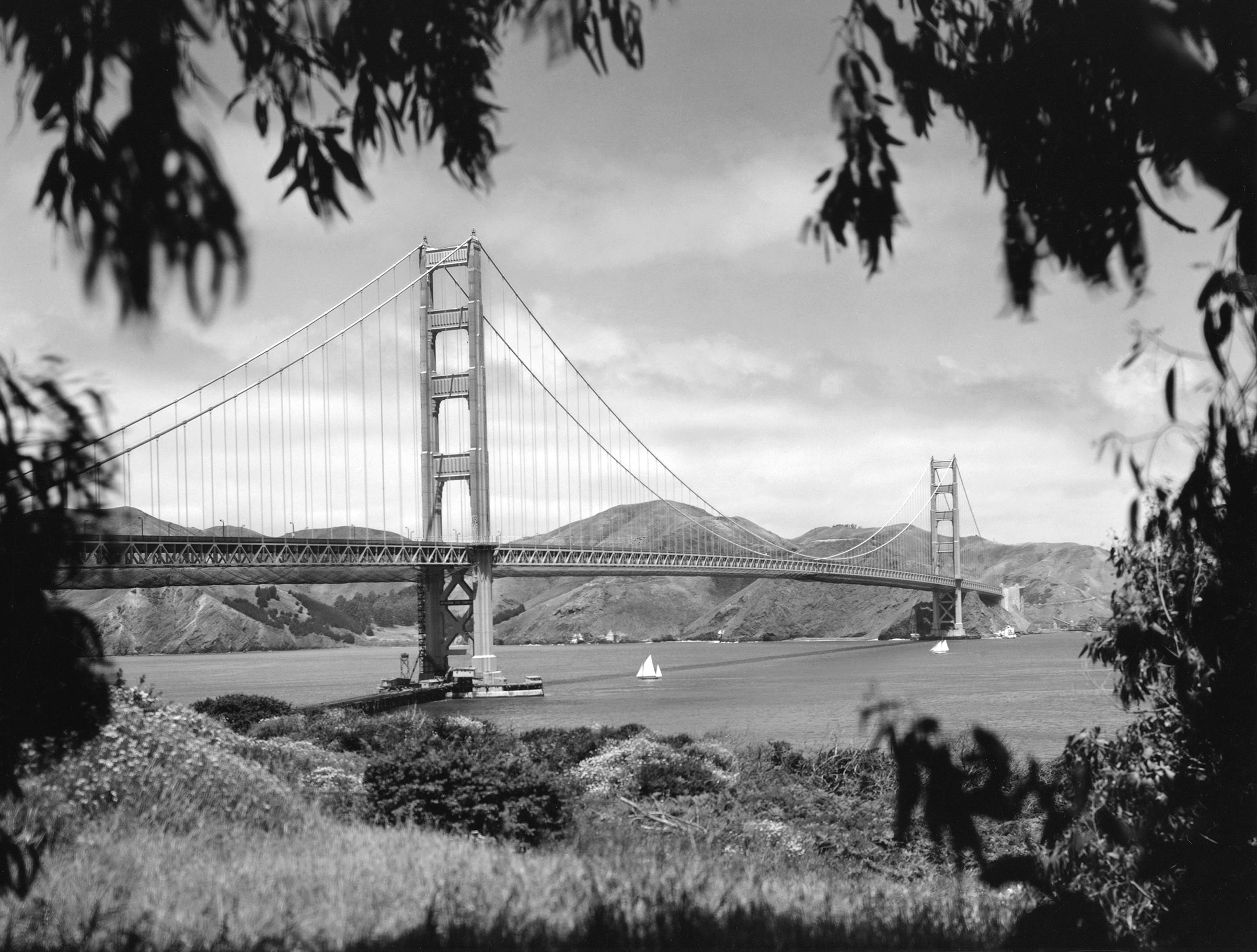 The nearly completed Golden Gate Bridge as seen from the Presidio with the Marin Headlands in the background, San Francisco, California, May 1937.