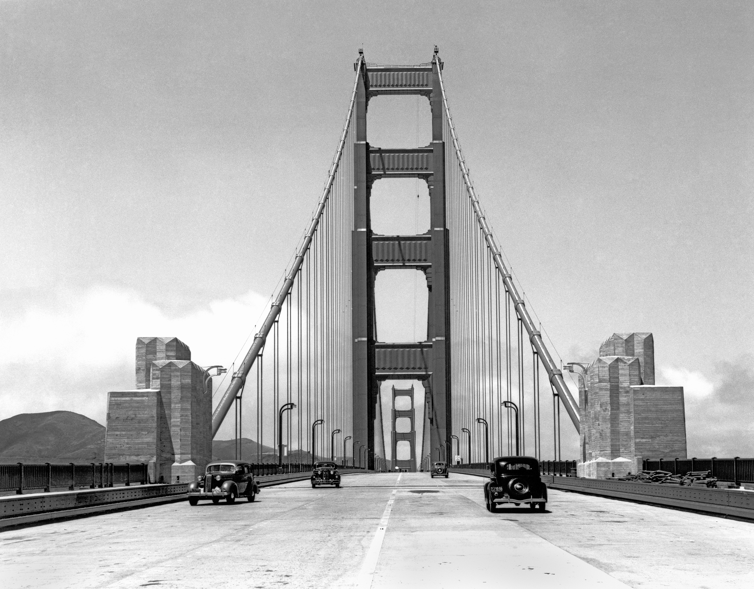 Press cars going across the about to be opened new Golden Gate Bridge, San Francisco, California, May 24, 1937.