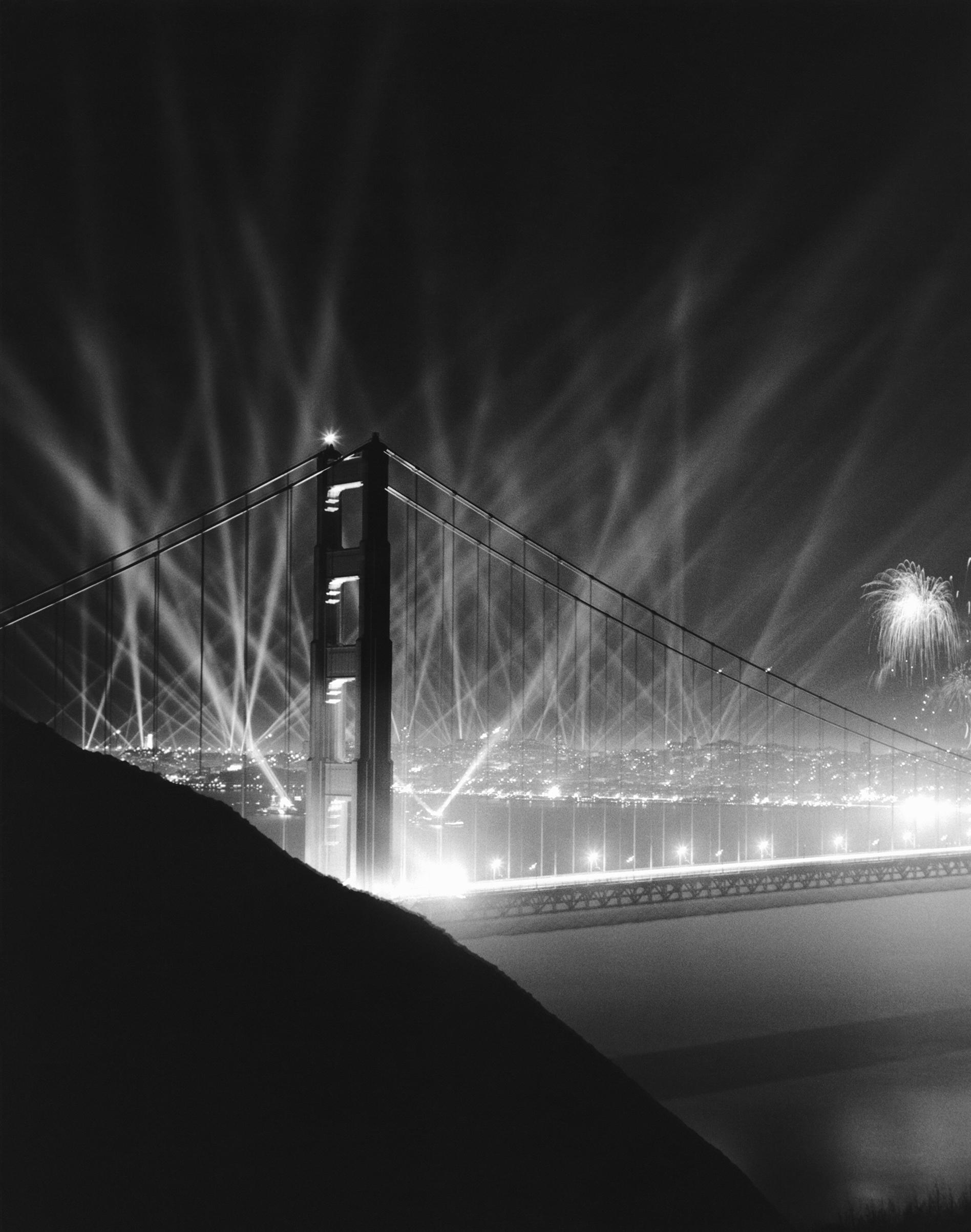 The official grand opening celebration with klieg lights and fireworks of the Golden Gate Bridge, San Francisco, California, May 29, 1937. The opening ceremonies lasted a week.