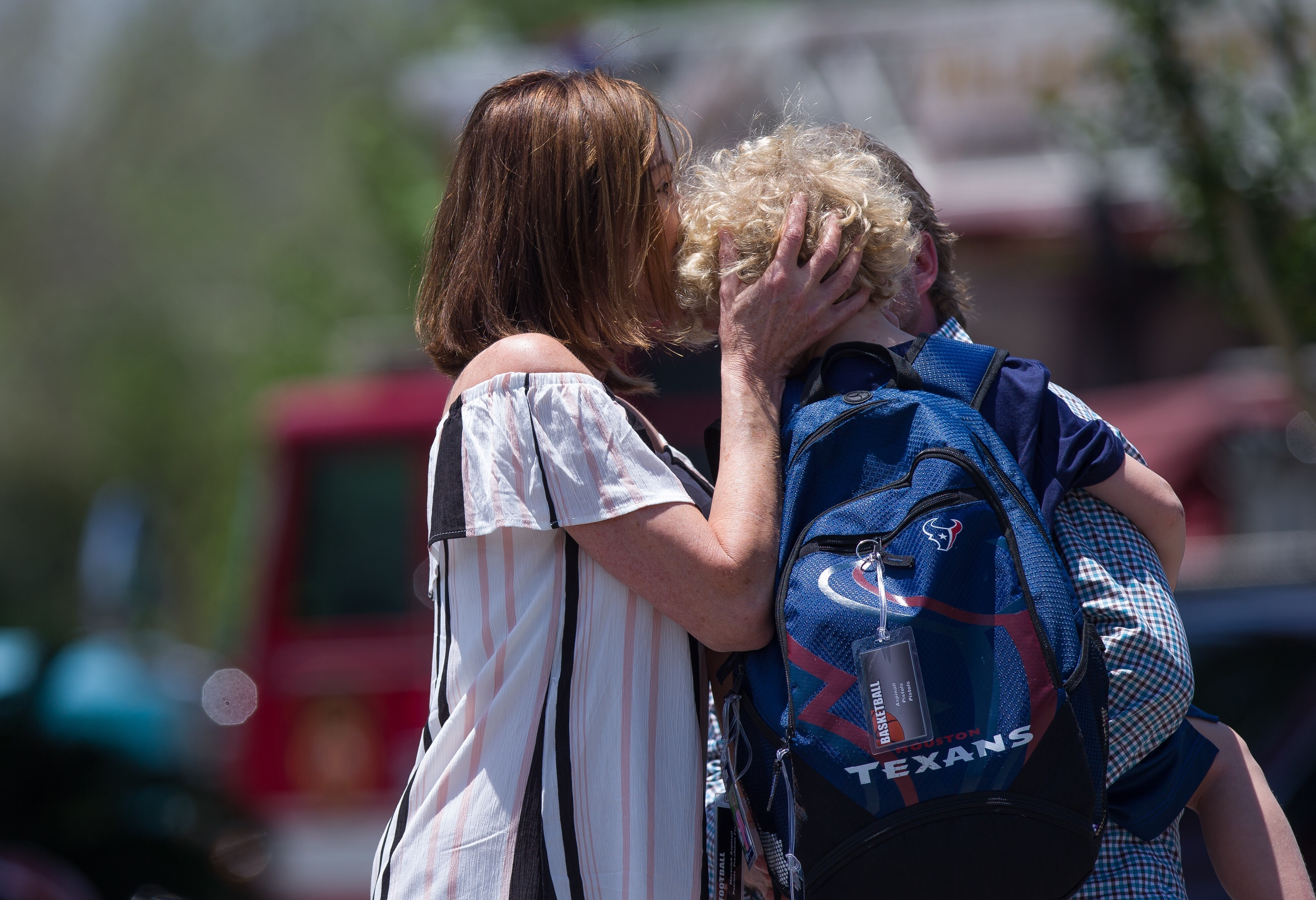 Parents picked up their children from school after a science experiment explosion injured children at the Yellow School at Memorial Drive Presbyterian Church, May 16, 2017, in Houston.