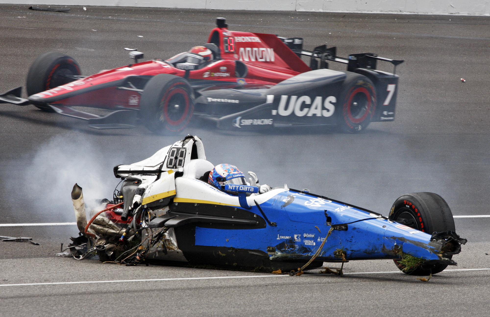 Scott Dixon, of New Zealand, sits in the remains of his car after going airborne in a crash during the running of the Indianapolis 500 auto race at Indianapolis Motor Speedway, on May 28, 2017, in Indianapolis.