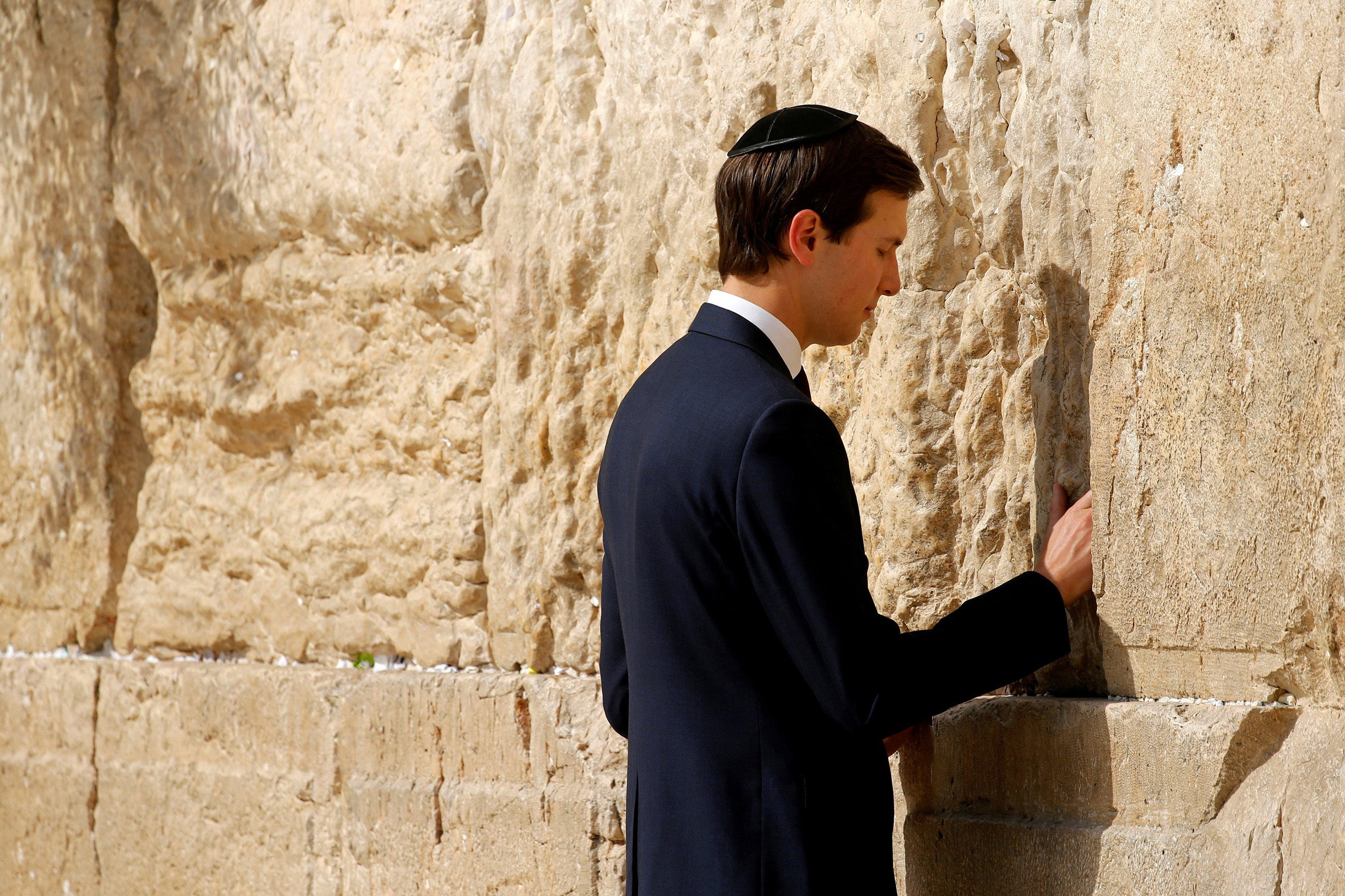 White House senior advisor Jared Kushner leaves a note at the Western Wall in Jerusalem May 22, 2017.
