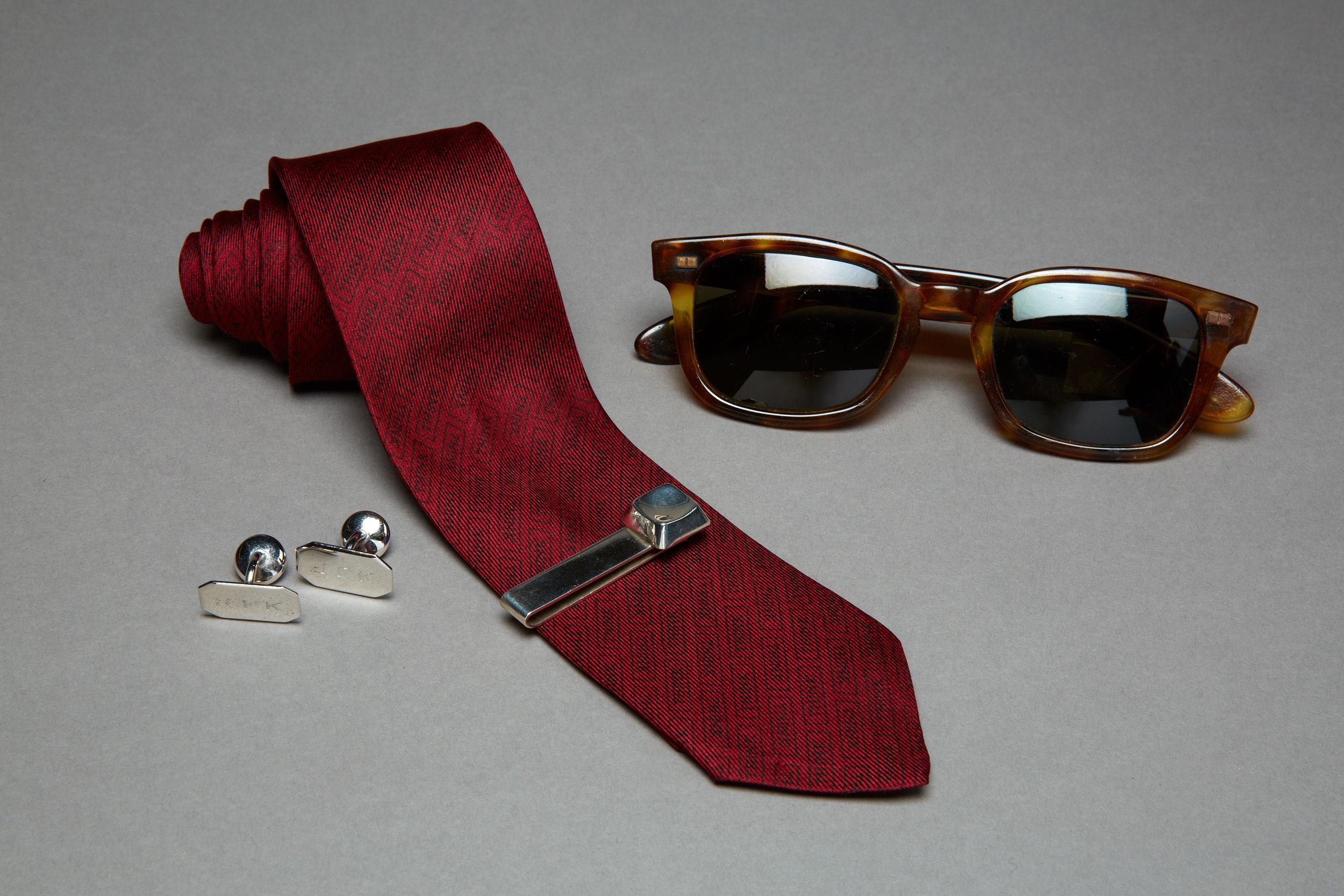 JFK's sunglasses, cuff links, tie clip and tie from JFK's personal wardrobe.