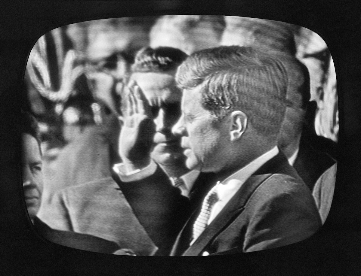 President John F. Kennedy taking the oath of office at his inauguration, January 20, 1961. Image shot of television screen.  Copyright © 1961 CBS Broadcasting Inc.
