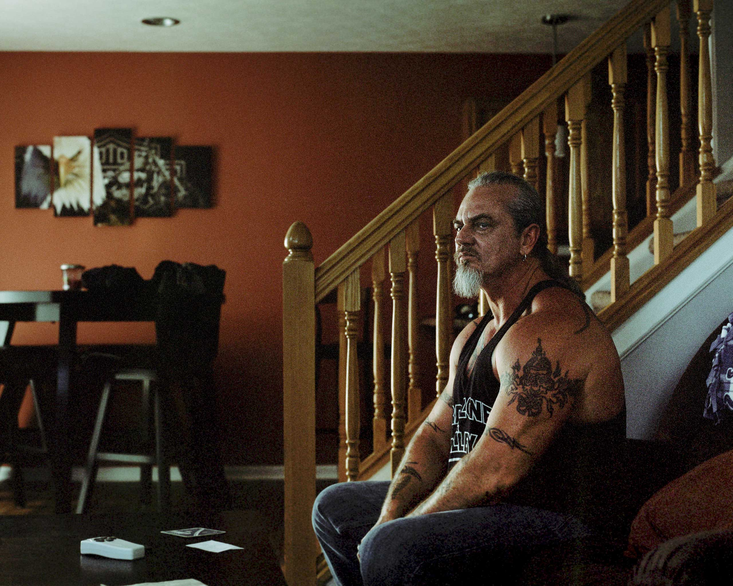 Rexnord machinist Brian Bousum, 51, at a friend's home in Indianapolis; after nearly 23 years, Bousum's job is being outsourced to Mexico