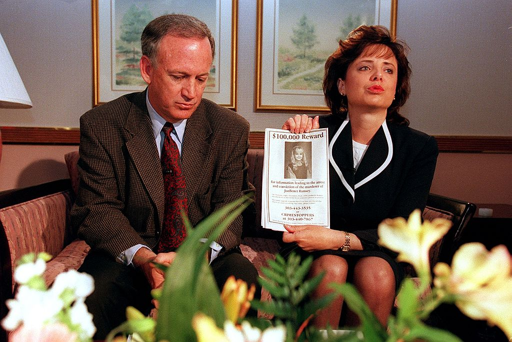 Patsy Ramsey holds up a reward sign for any information about the death of their daughter JonBenet Ramsey in Boulder, Colorado on May 1, 1997.