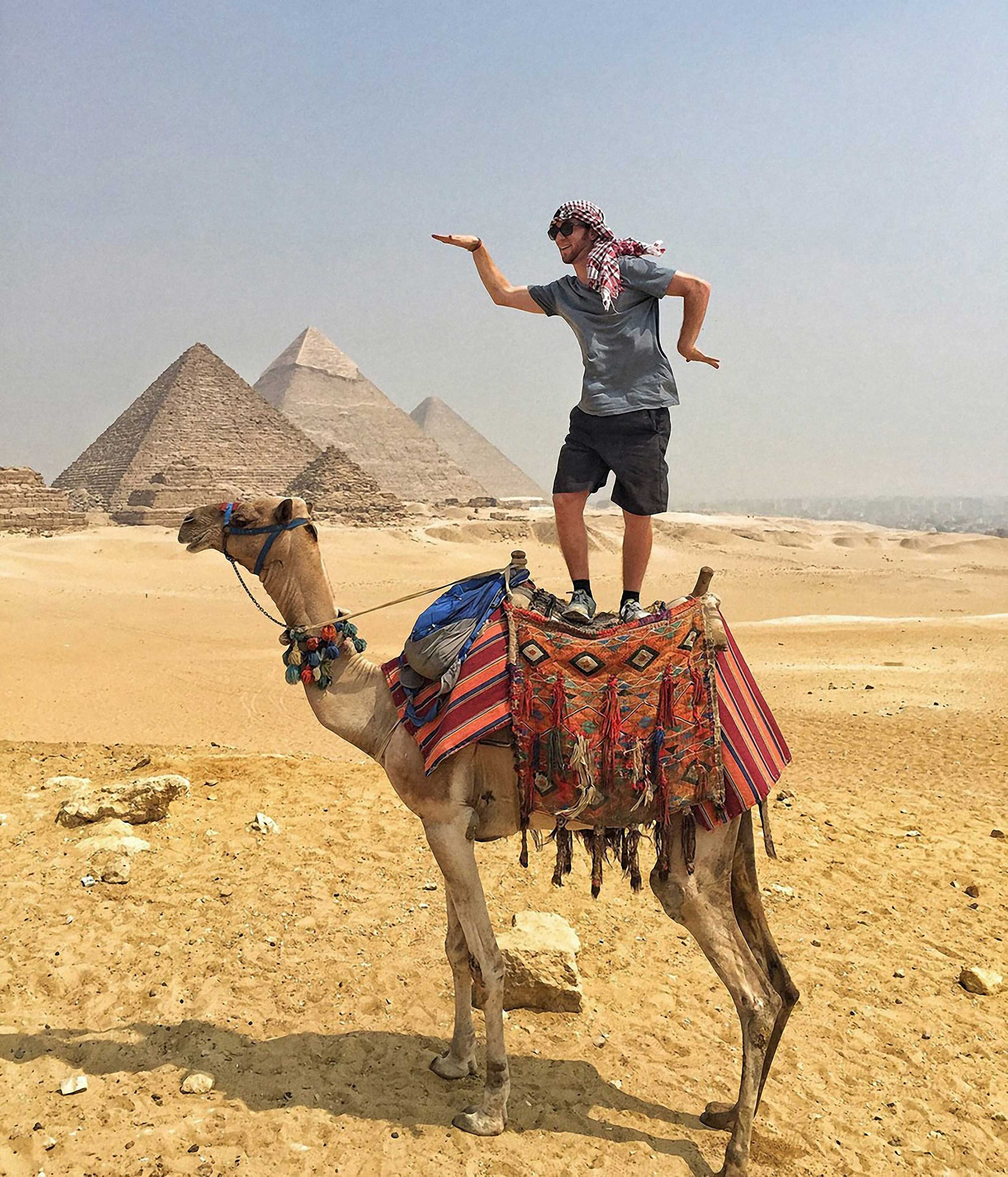 Egyptian Walk On a Camel.  I'm glad that I came here, because seeing the Pyramids of Giza was one of the best travel experiences of my life. I took a 2 hour camel ride around the desert and it was something I'll never forget.'' Cairo, Egypt, 2015.