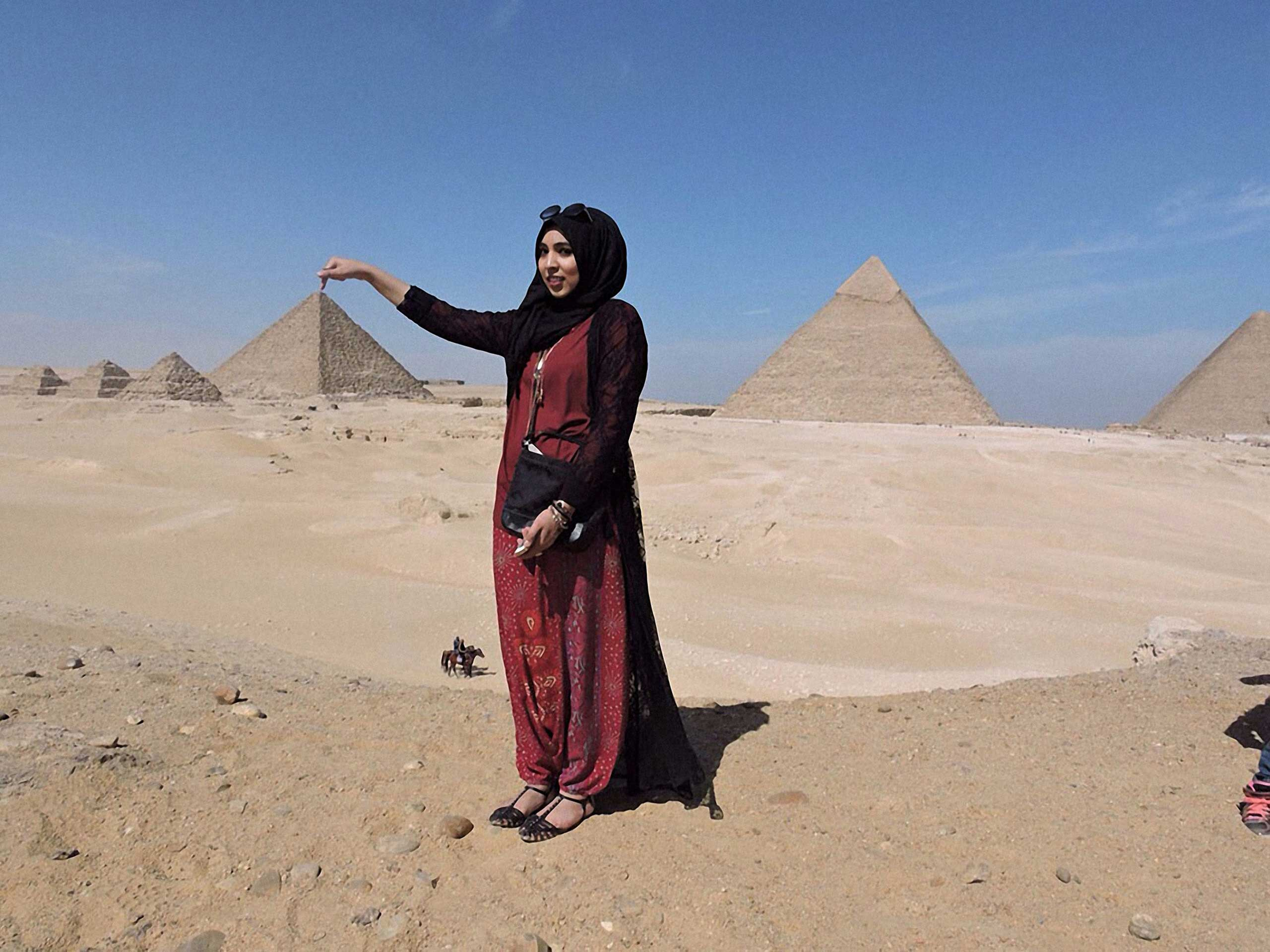 Touch the Pyramids II.  Look at me touching the top of the pyramids. I went to Egypt for this picture and I'm so glad I got it, also got one of me jumping over the pyramids but going to keep that to myself . Cairo, Egypt, 2015.