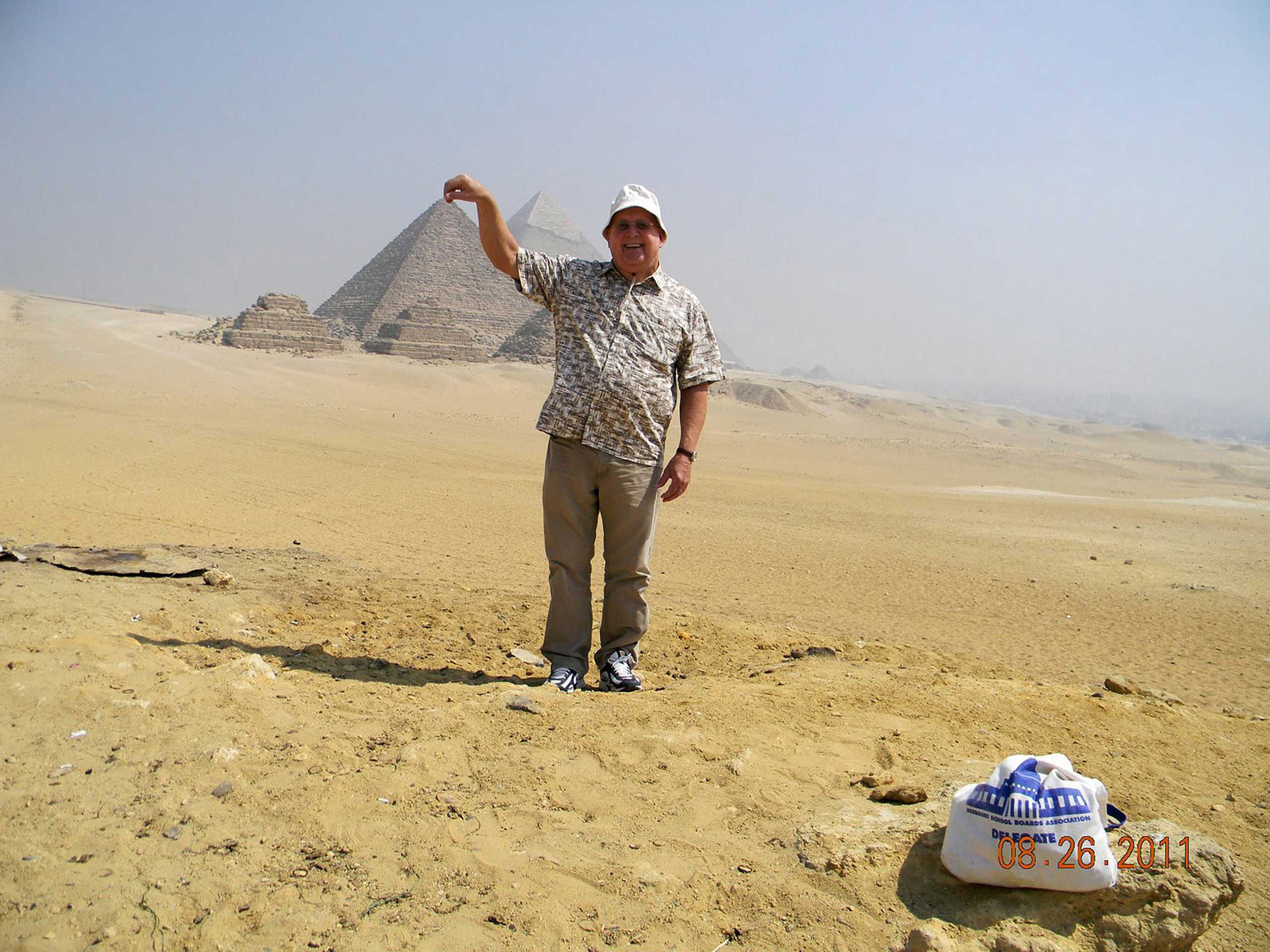 Touch the Pyramids III.  Are the pyramids really that tall? Look, I am touching the top of the tallest one . Cairo, Egypt, 2011.