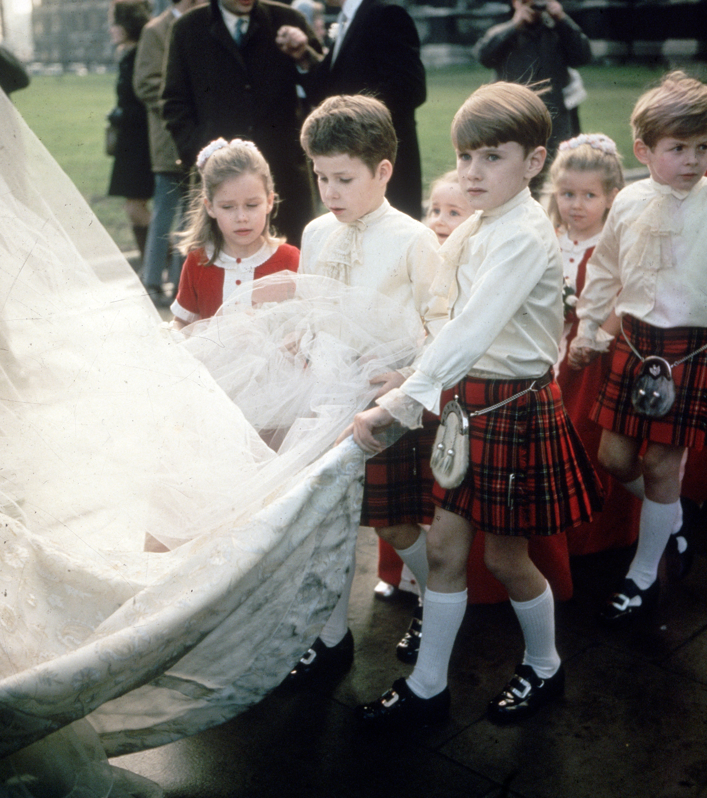 Princess Margaret's children, Viscount David Linley and his sister, Sarah Armstrong-Jones, among the pageboys and bridesmaids at a society wedding. 1975.