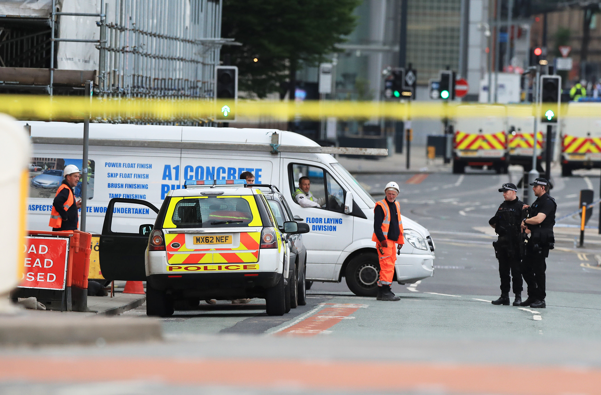 Police near the Manchester Arena the morning after an attack at the end of a concert by Ariana Grande left 22 dead, on May 23, 2017.