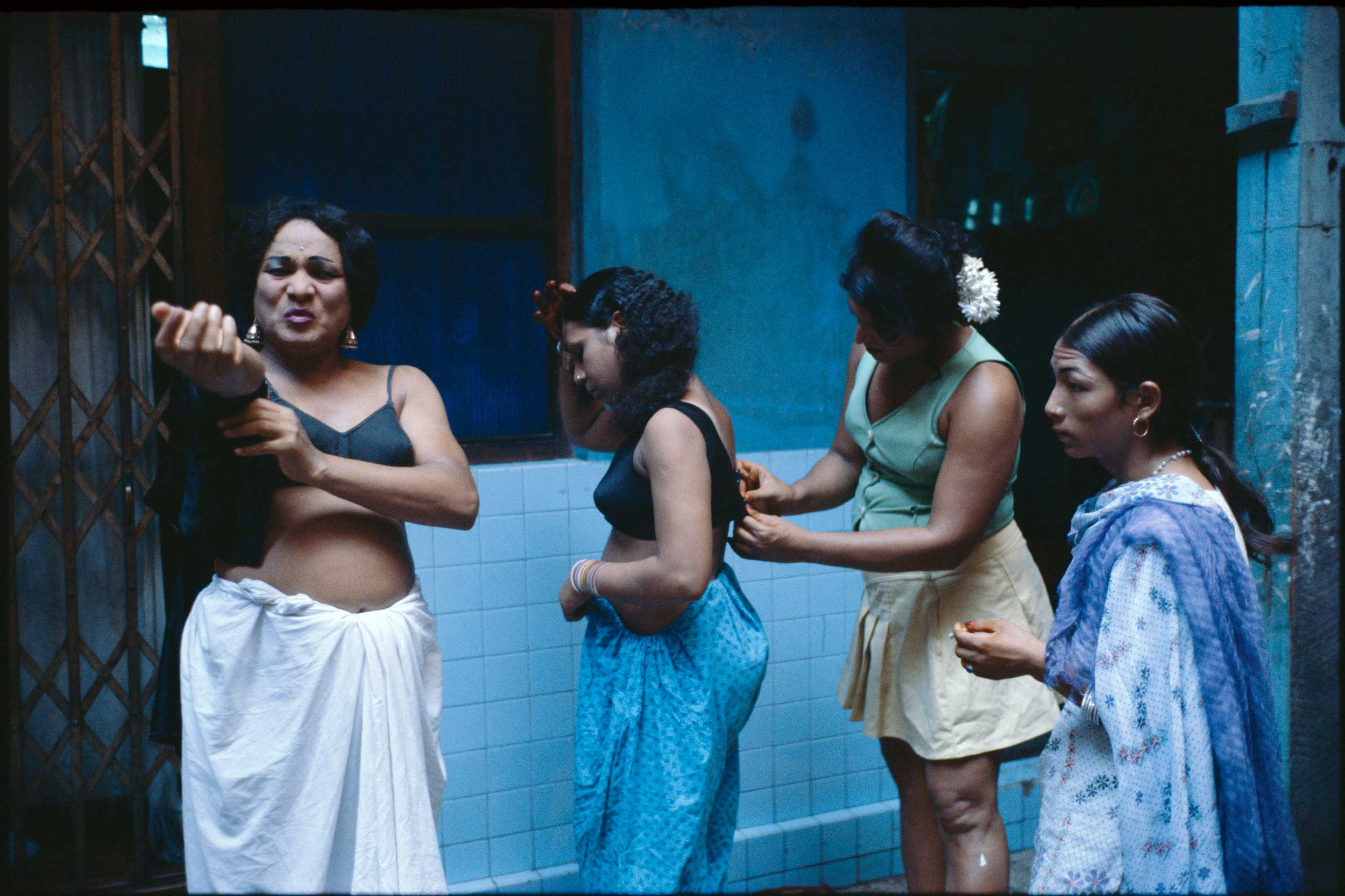 Transvestites getting dressed in a courtyard. 1978.