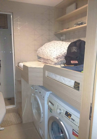 Hong Kong's Mission for Migrant Workers says it was sent this photo by a domestic worker in Hong Kong, showing a bed built above a washing machine and dryer that she alleges is her sleeping area
